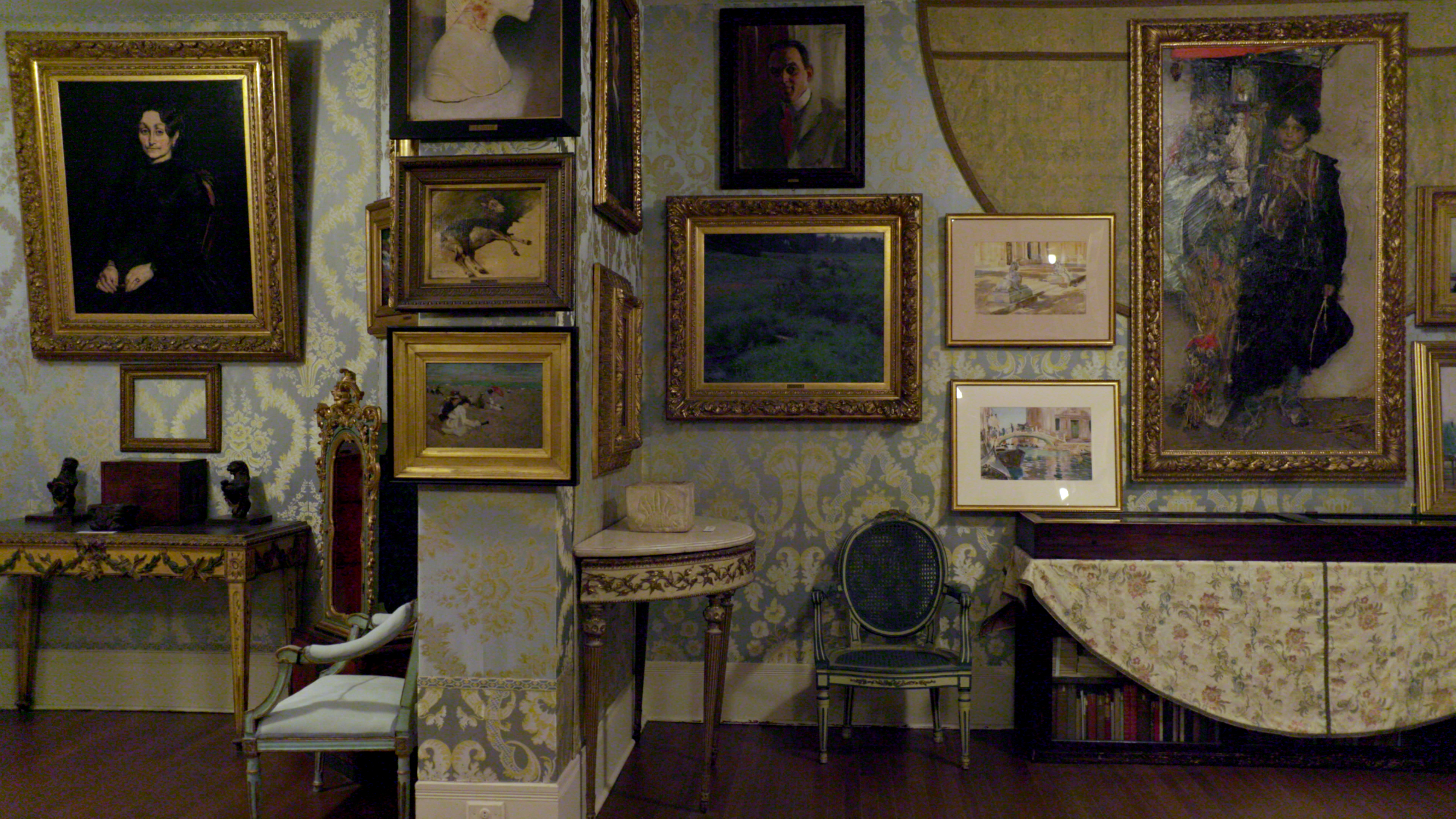 Paintings on the wall of a museum.