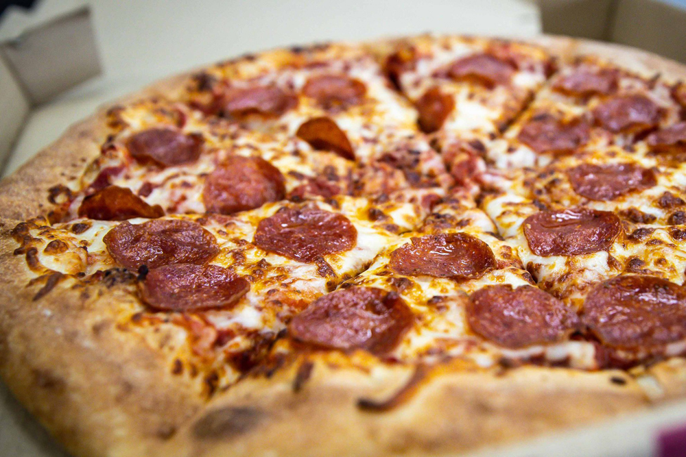 A pepperoni pie, on the affordably priced menu at Perfect Pizza, headed to Spring Valley.