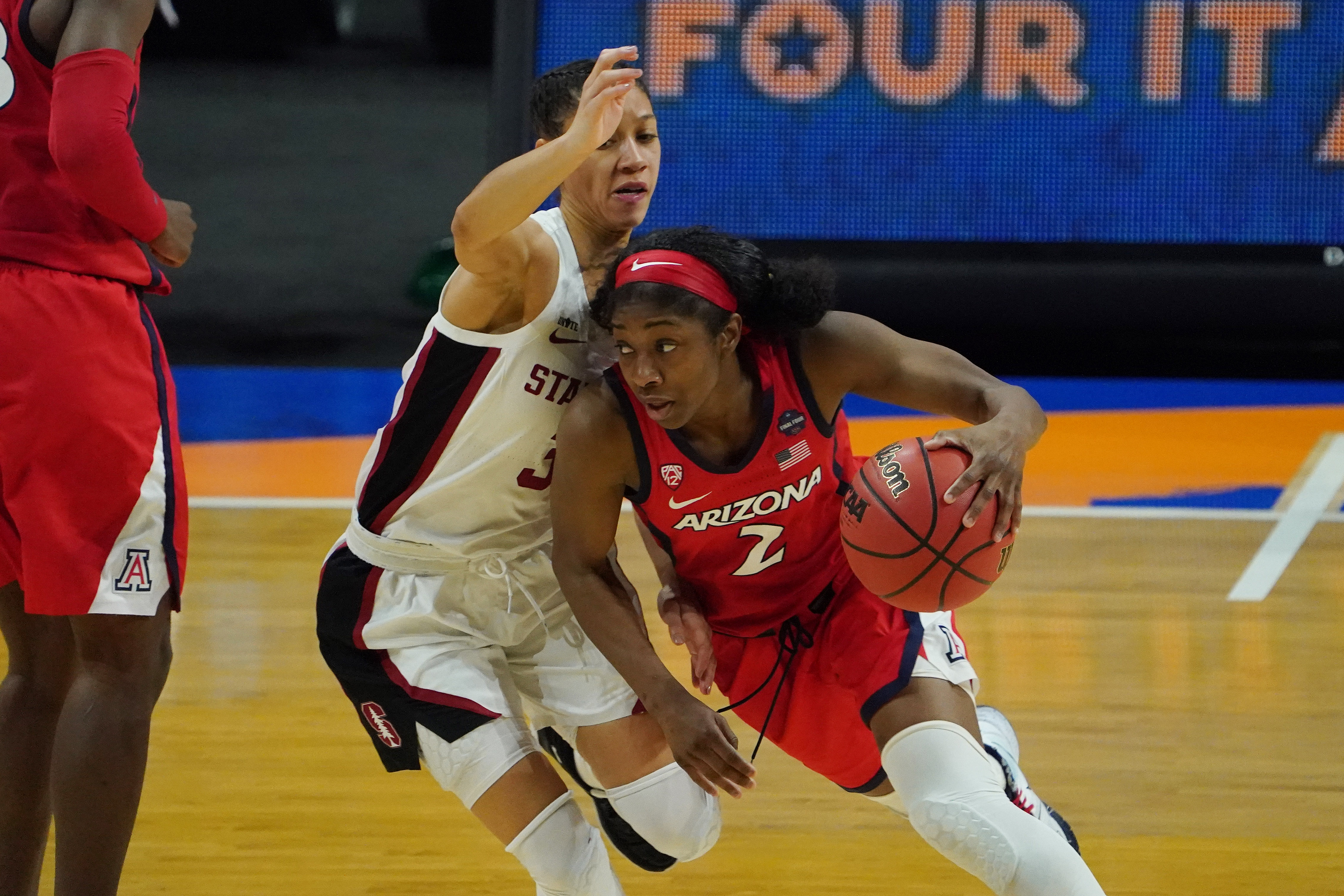 Arizona Wildcats guard Aari McDonald dribbles the ball as Stanford Cardinal guard Anna Wilson defends during the second half in the national championship game of the women's Final Four of the 2021 NCAA Tournament at Alamodome.