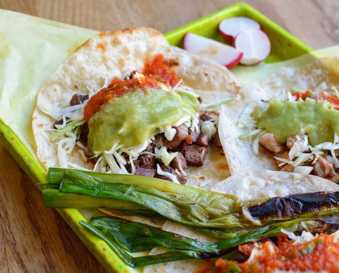 Sonoratown's flour tortilla taco with guacamole salsa on top.