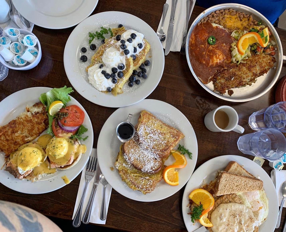 Plates of sweet and savory breakfast and brunch favorites, on the menu at Peg's Glorified Ham n Eggs.
