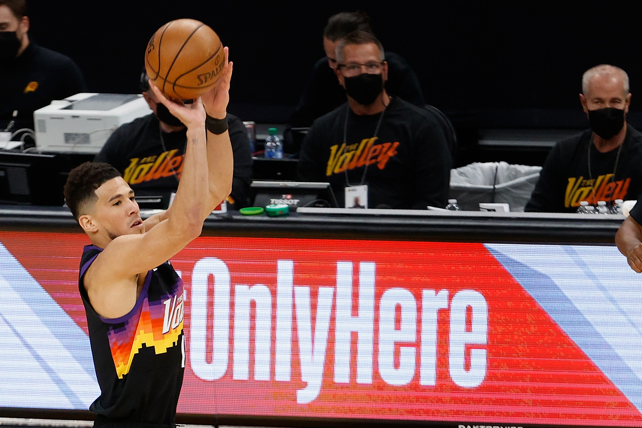 Devin Booker #1 of the Phoenix Suns attempts a shot against the Utah Jazz during the first half of the NBA game at Phoenix Suns Arena on April 07, 2021 in Phoenix, Arizona. The Suns defeated the Jazz 117-113 in overtime.