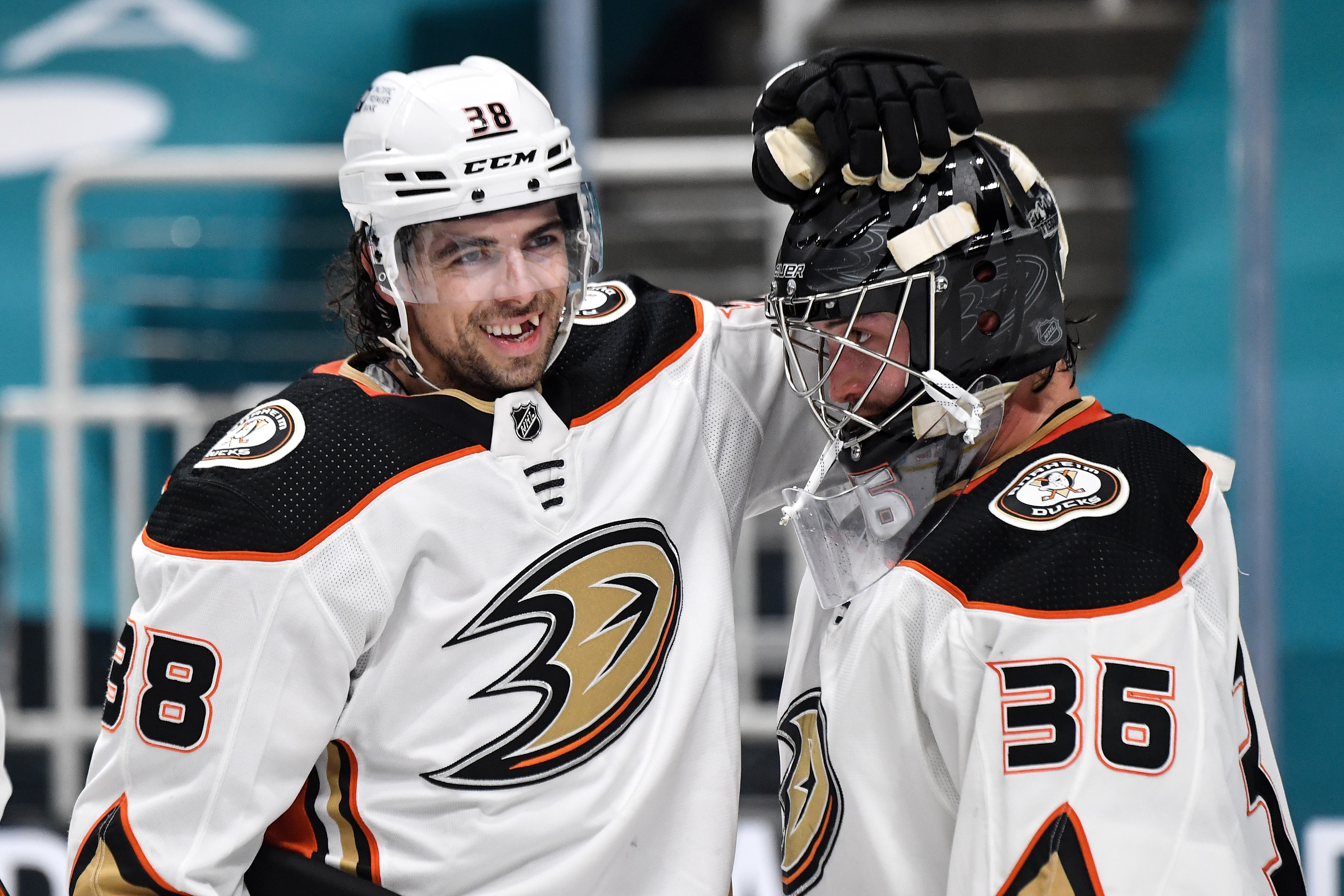 Derek Grant #38 and John Gibson #36 of the Anaheim Ducks celebrate after defeating the San Jose Sharks 5-1 at SAP Center on April 6, 2021 in San Jose, California.