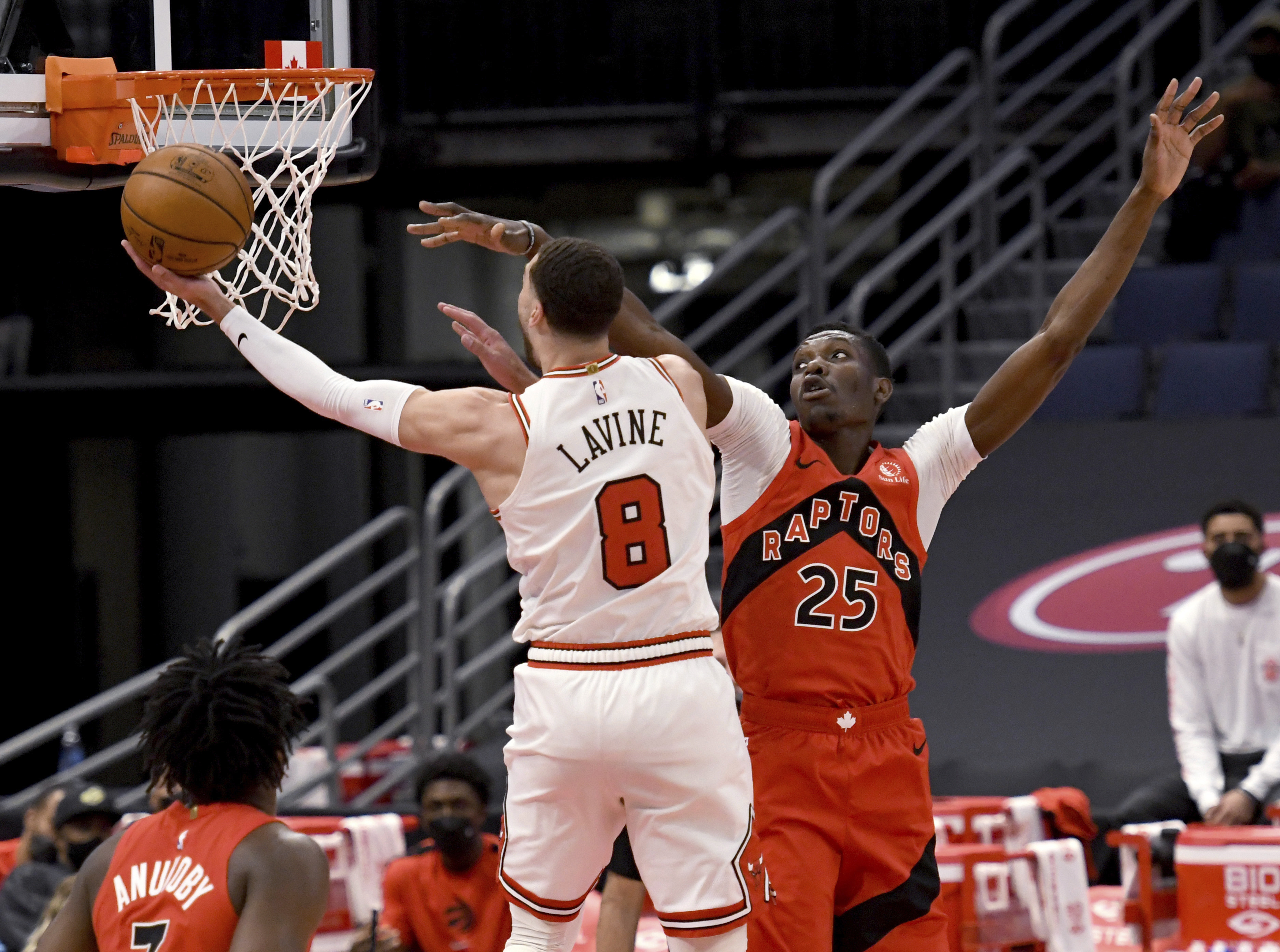 Bulls guard Zach LaVine shoots against Raptors forward Chris Boucher during the first half of Thursday's game.