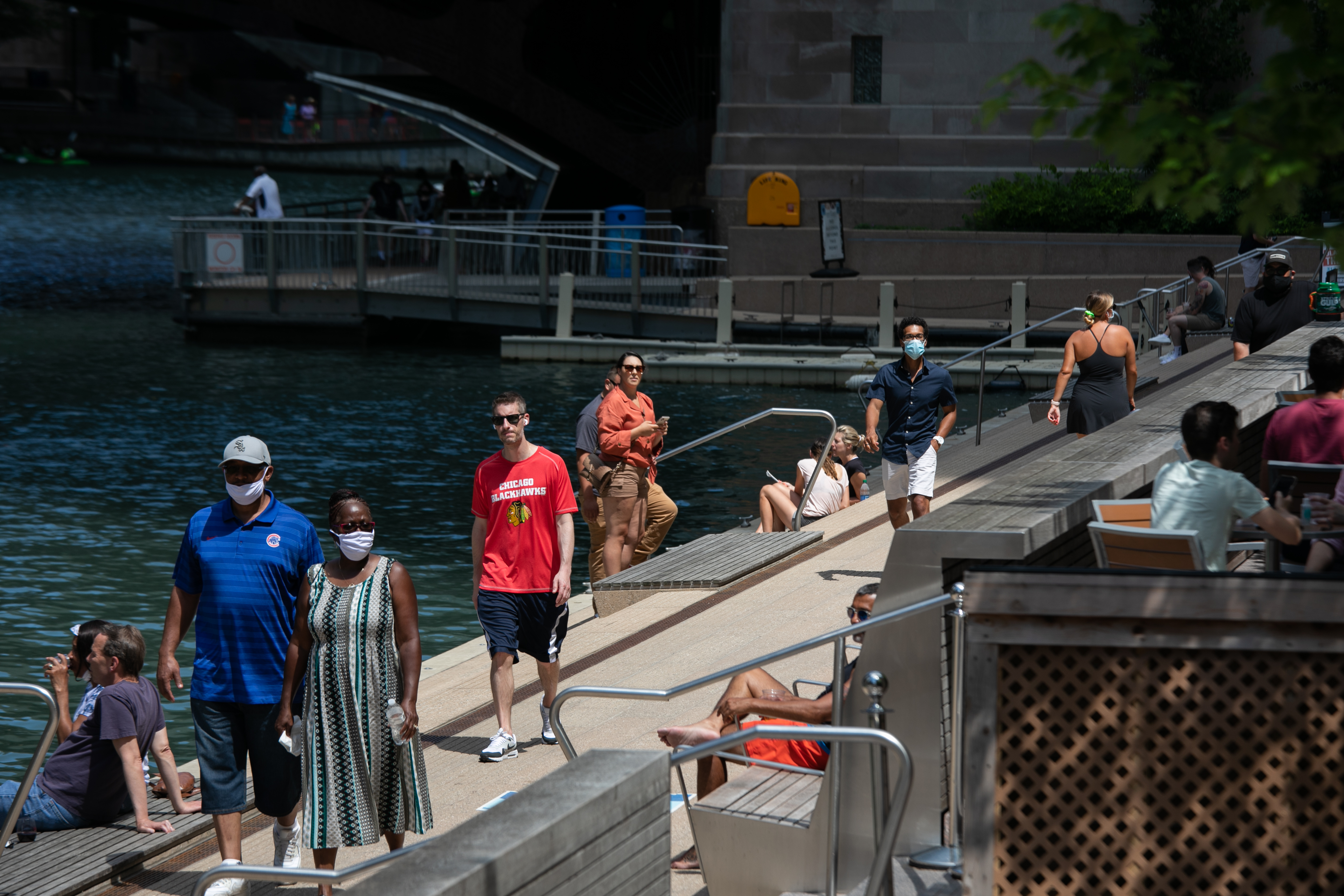 People take a stroll along the Riverwalk Friday afternoon, July 10, 2020. The Riverwalk is now open from 6 a.m. to 11 p.m. When the Riverwalk re-opened in June, hours were limited to prevent crowding and the spread of COVID-19.   Pat Nabong/Sun-Times