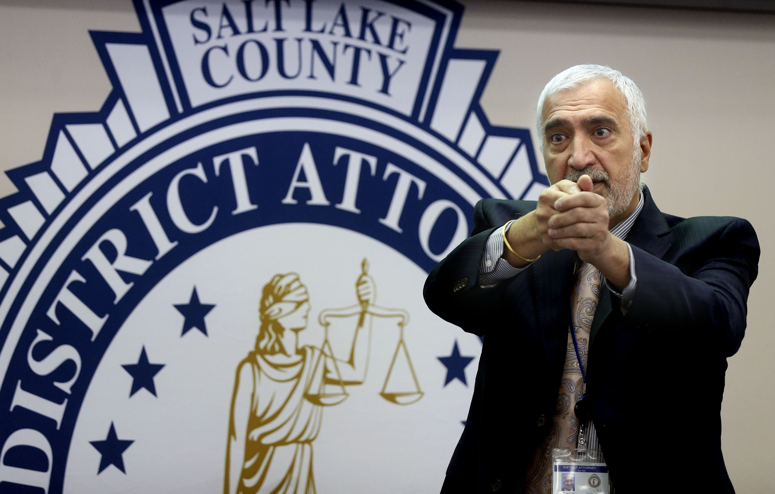 Salt Lake County District Attorney Sim Gill holds his hands up as if firing a gun during a press conference at the District Attorney's Office in Salt Lake City on Friday, April 9, 2021. During the press conference, Gill announced three police officers who shot and killed Matthew C. Knowlden, 22, after he pointed a gun at them on Sept. 18, 2020, were legally justified in doing so, even though the man never fired a shot.