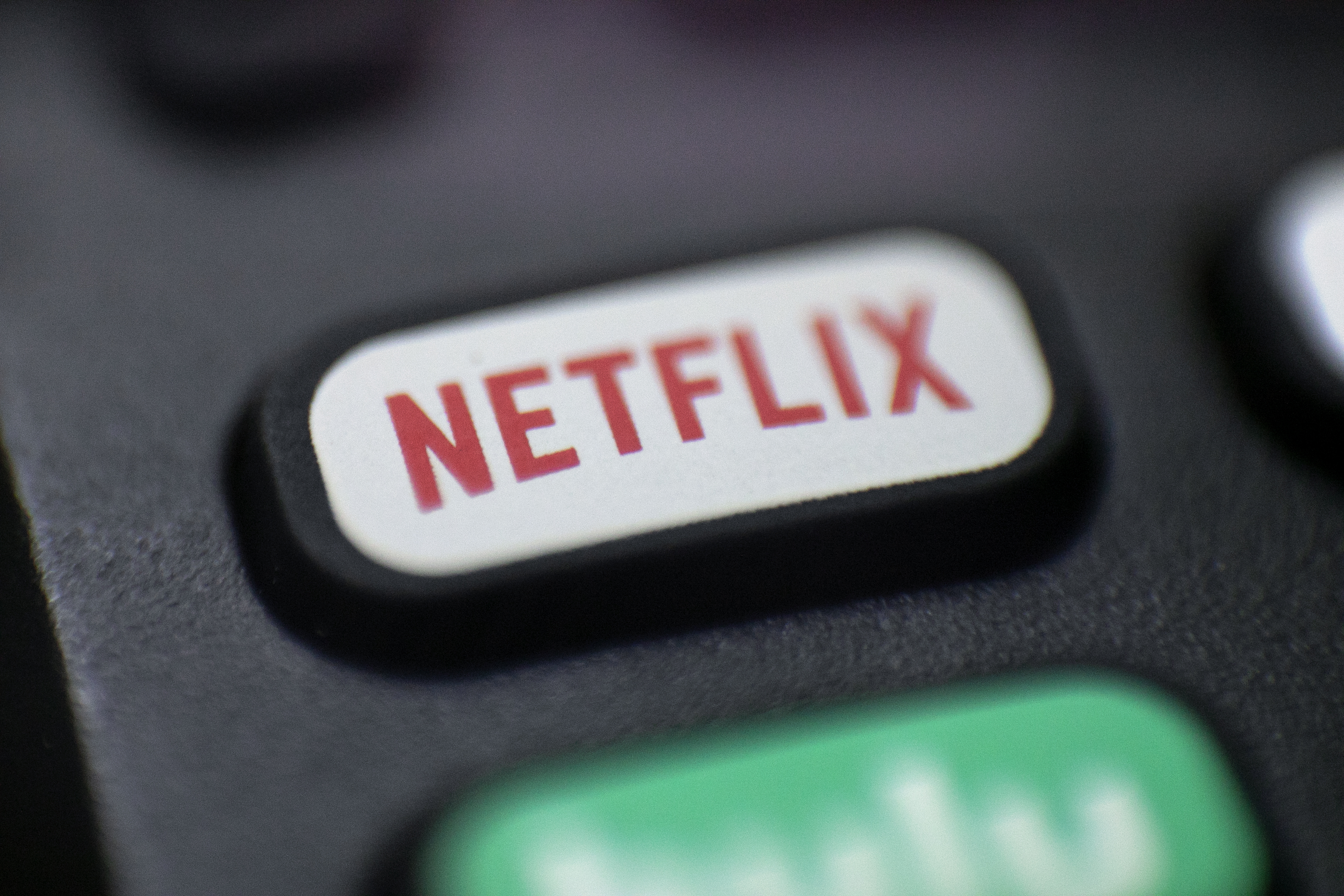 This Aug. 13, 2020, photo shows a logo for Netflix on a remote control in Portland, Ore.