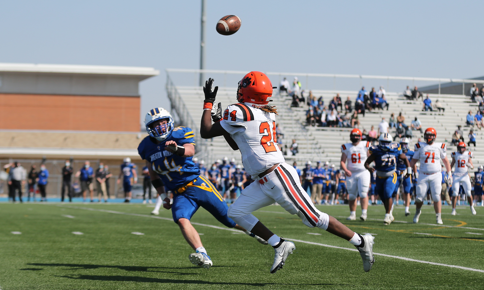 Wheaton Warrenville South's Eddie Robbinson (24) catches a pass for a touchdown against Wheaton North.
