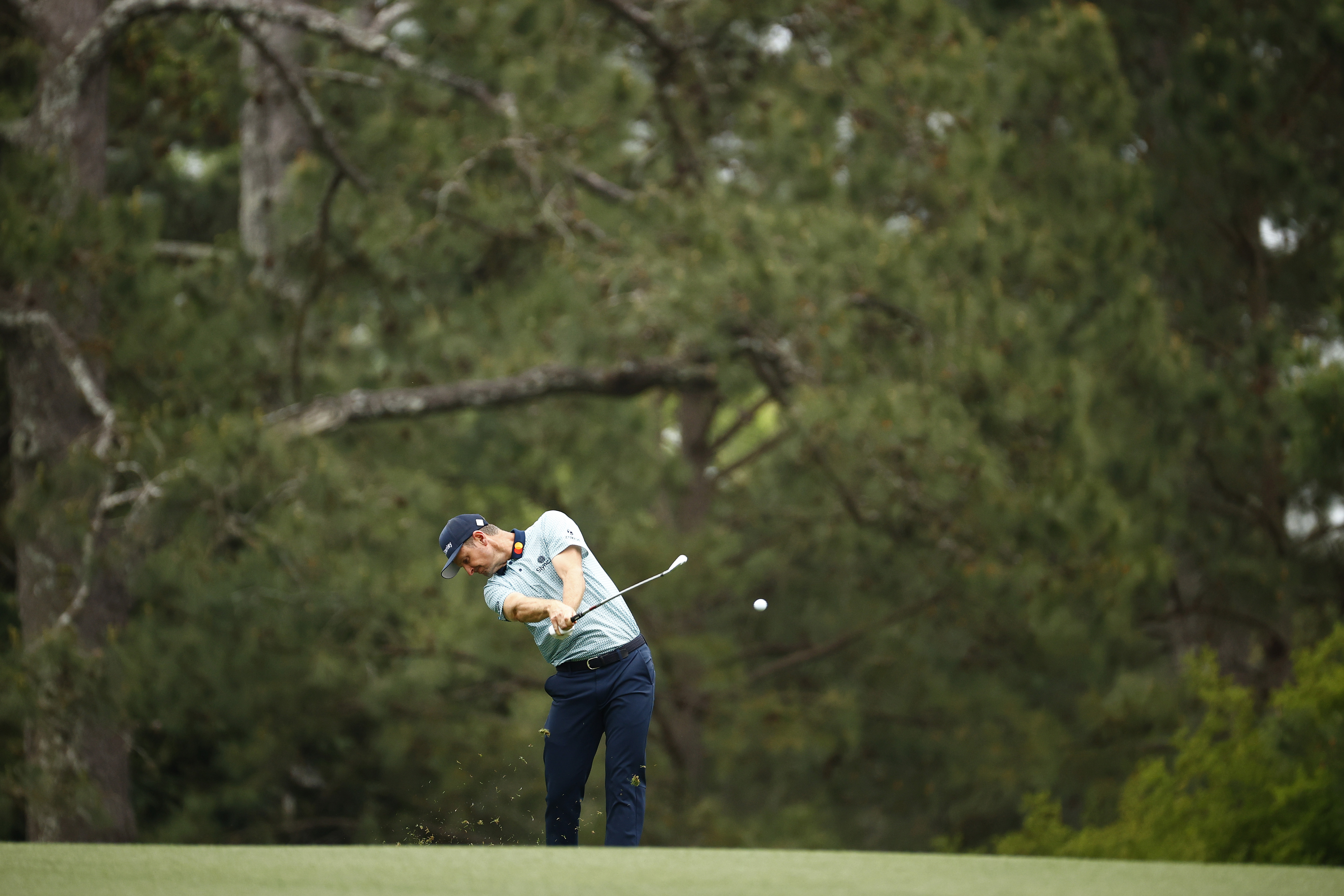 Justin Rose of England plays a shot on the 15th hole during the second round of the Masters at Augusta National Golf Club on April 09, 2021 in Augusta, Georgia.