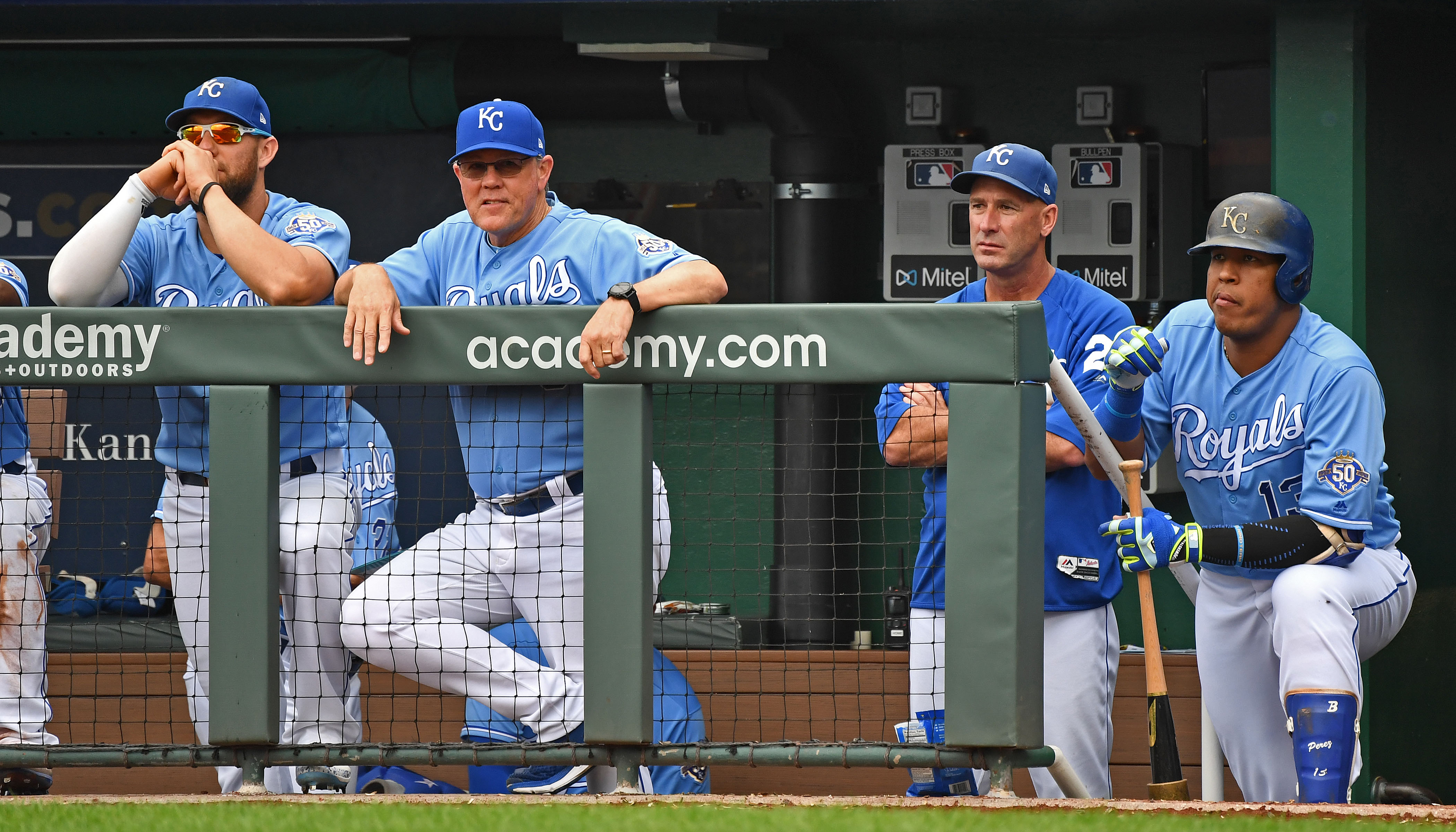 Royals manager Ned Yost (left center) looks on from the dugout with left fielder Alex Gordon (far left), bench coach Dale Sveum (right center) and designated hitter Salvador Perez (far right)