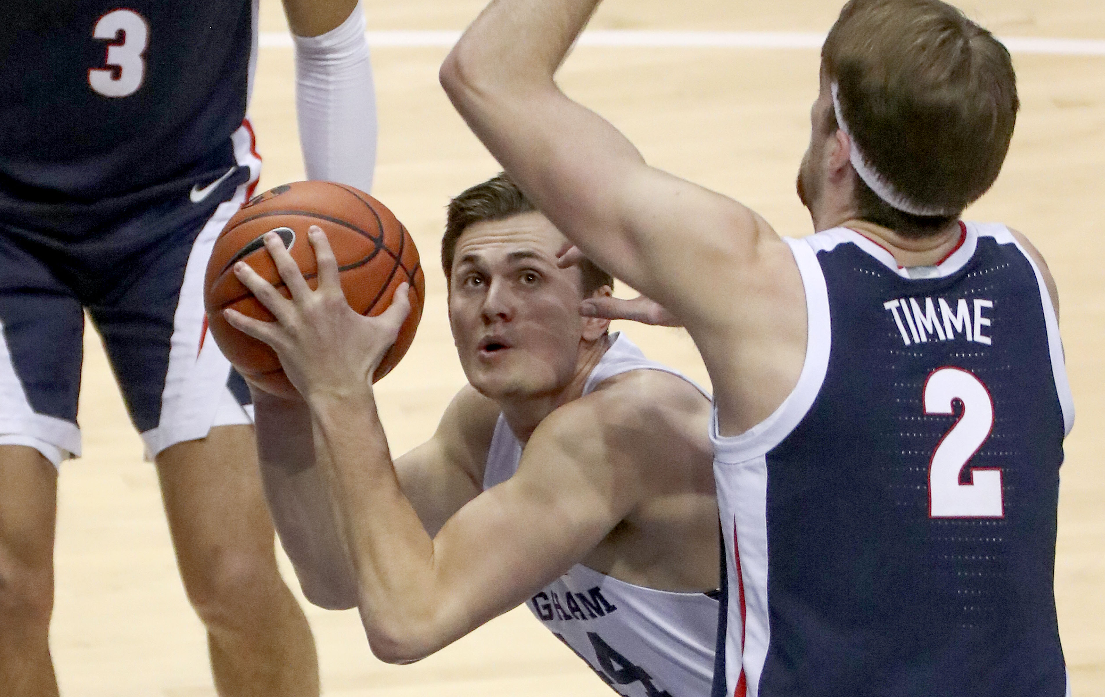 Brigham Young Cougars guard Connor Harding (44) shoots under Gonzaga Bulldogs forward Drew Timme (2) during a basketball game at the Marriott Center in Provo on Monday, Feb. 8, 2021. BYU lost 71-82.