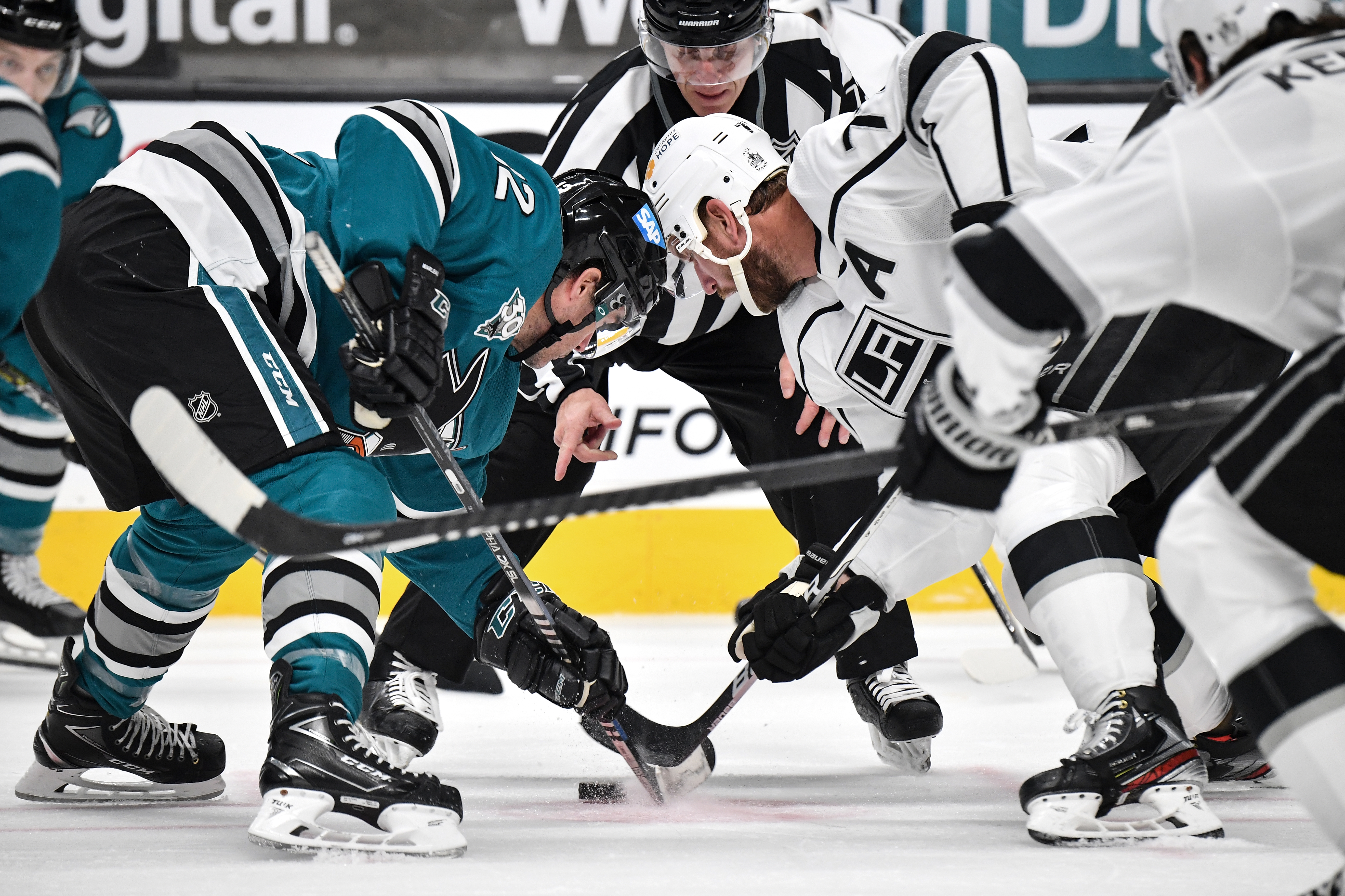 Patrick Marleau #12 of the San Jose Sharks takes a face-off against Jeff Carter #77 the Los Angeles Kings at SAP Center on April 9, 2021 in San Jose, California.