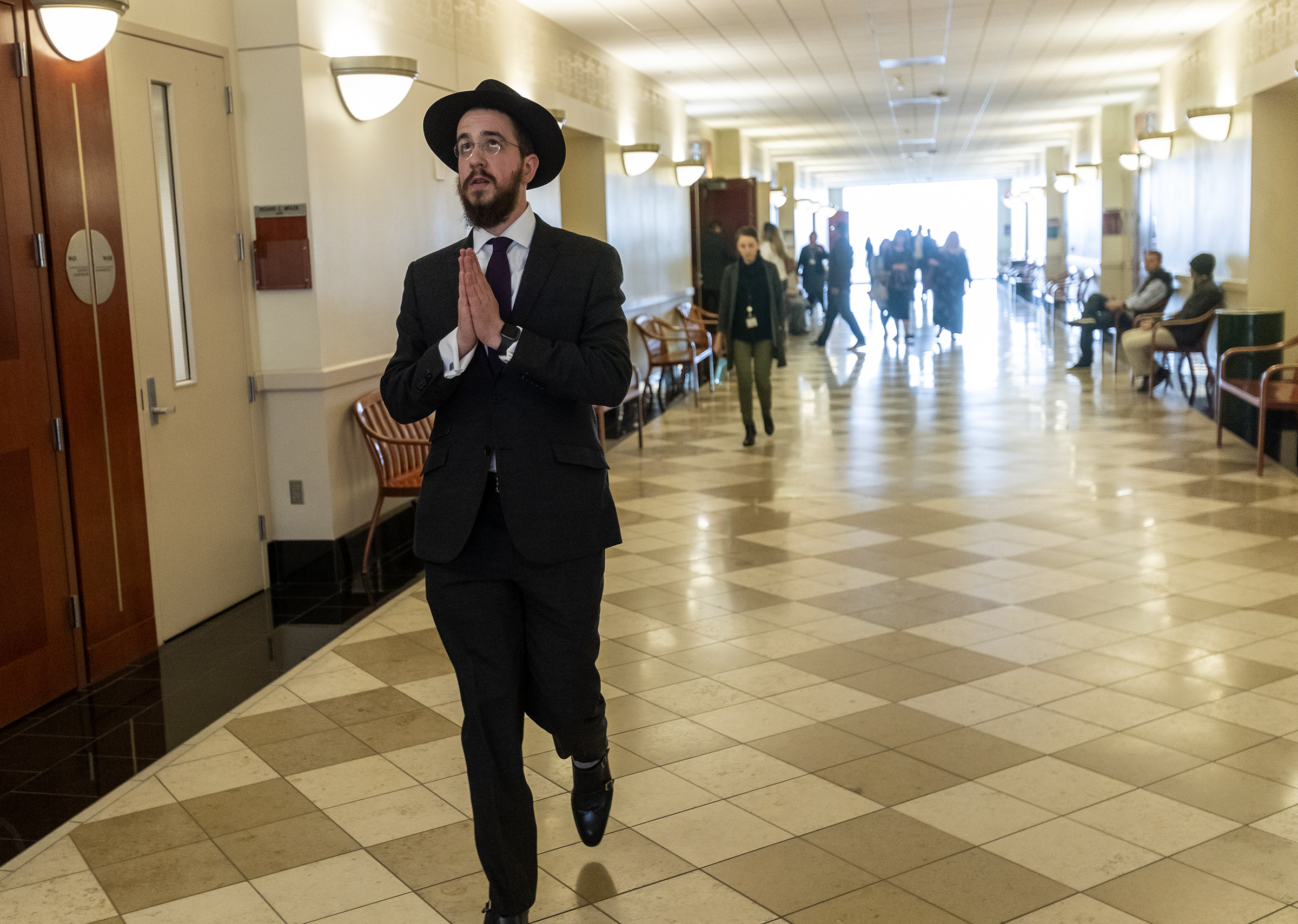 """Rabbi Avrohom """"Avremi"""" Zippel walks away from a courtroom in the Matheson Courthouse in Salt Lake City on Friday, Nov. 15, 2019, after his former nanny was found guilty on five counts of aggravated sexual abuse of a child, a first-degree felony, and two counts of forcible sex abuse, a second-degree felony."""