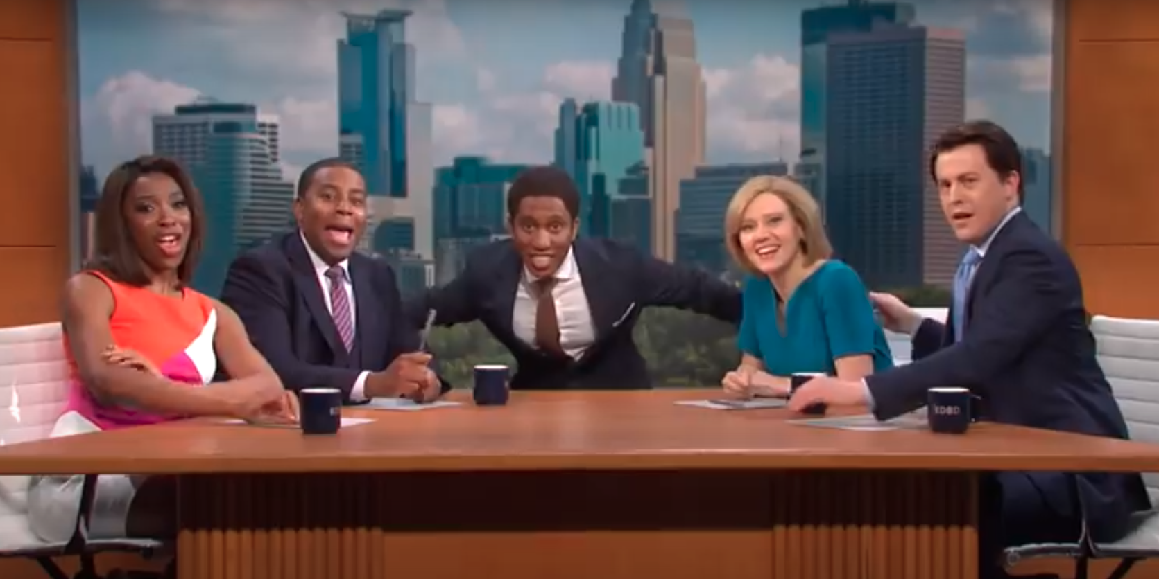 Anchors on a mock morning show on the Saturday Night Live cold open are seen sitting around a table. Pictured are from left to right, Ego Nwodim, Kenan Thompson, Chris Redd, Kate McKinnon and Alex Moffat.