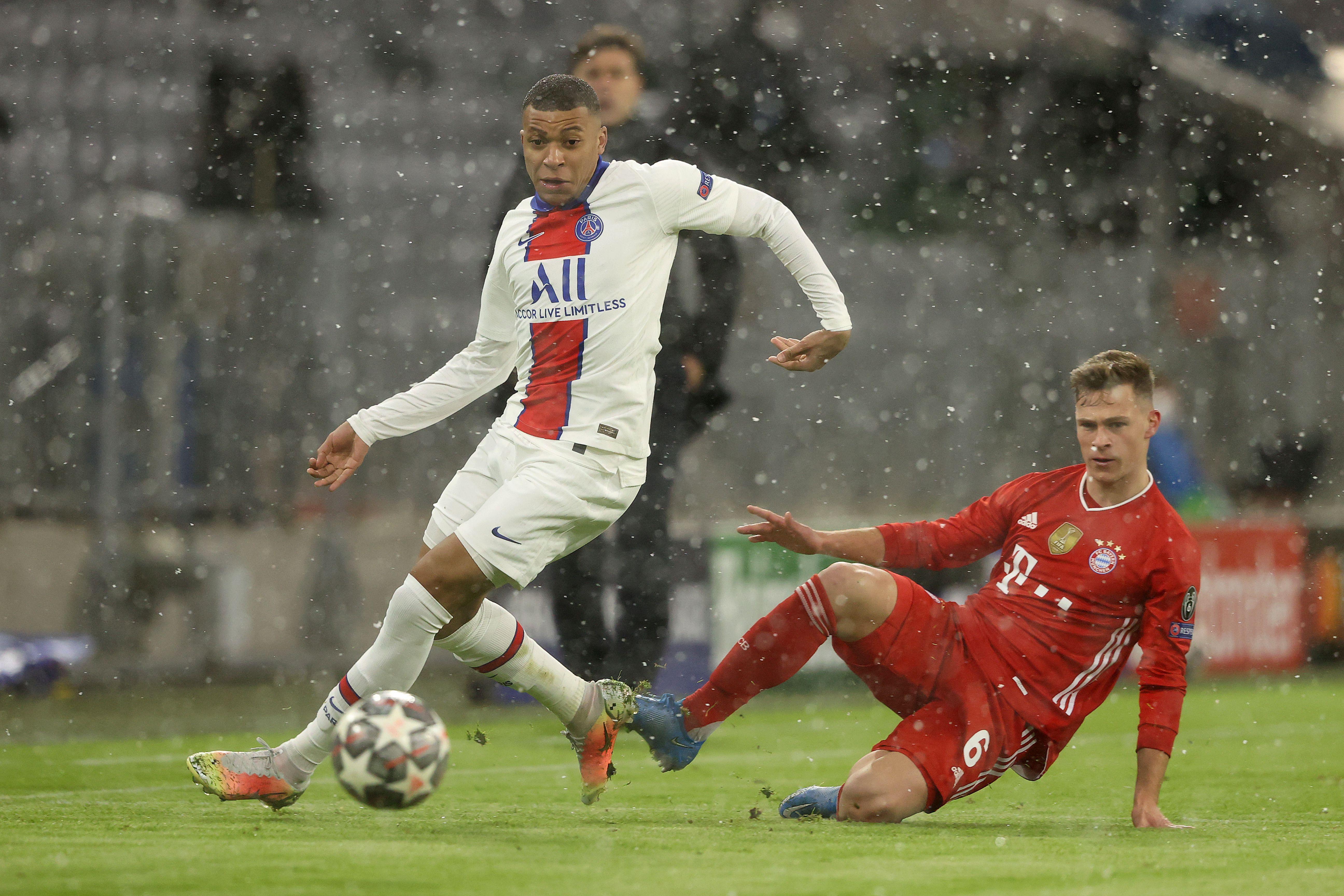 Kylian Mbappe breaks away from Joshua Kimmich - FC Bayern Munich v Paris Saint-Germain - UEFA Champions League Quarter Final: Leg One