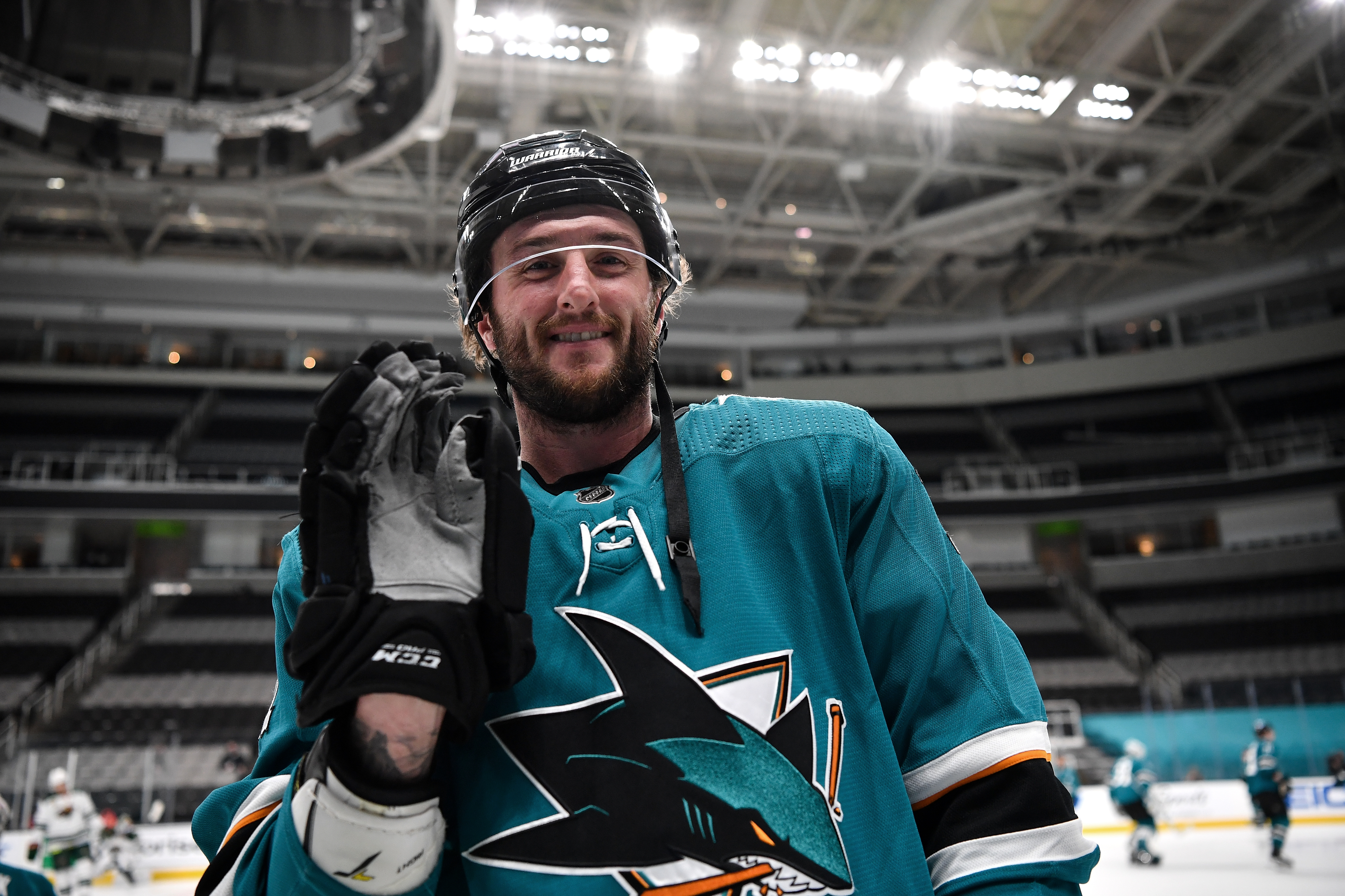 Stefan Noesen #11 of the San Jose Sharks smiles during warmups against the Minnesota Wild at SAP Center on February 22, 2021 in San Jose, California.