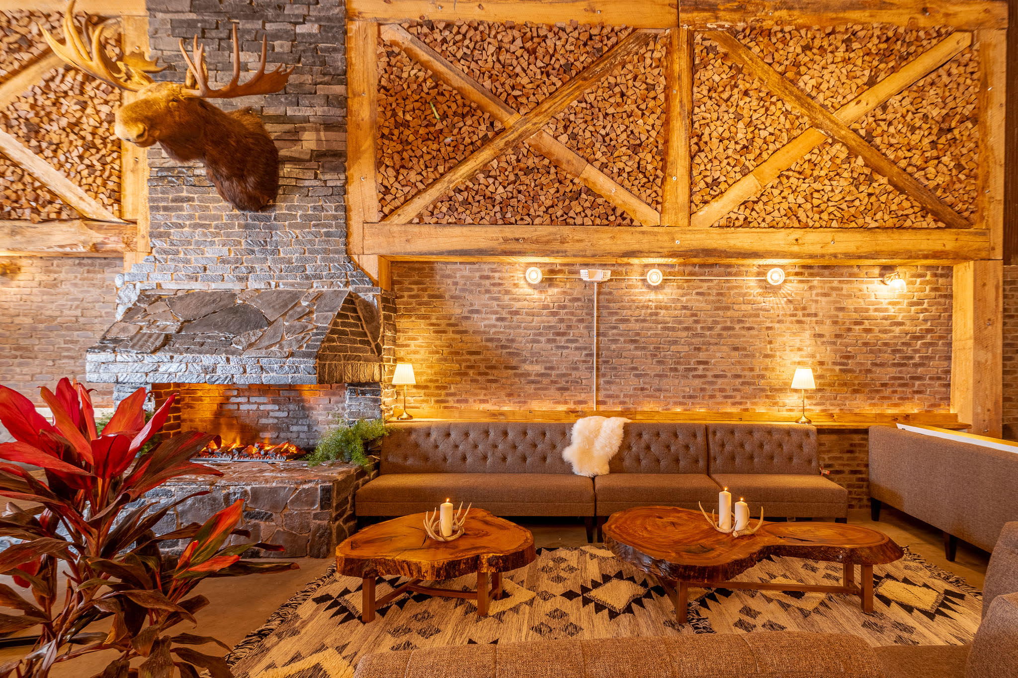 inside restaurant with brick wall, leather chair, moose antler