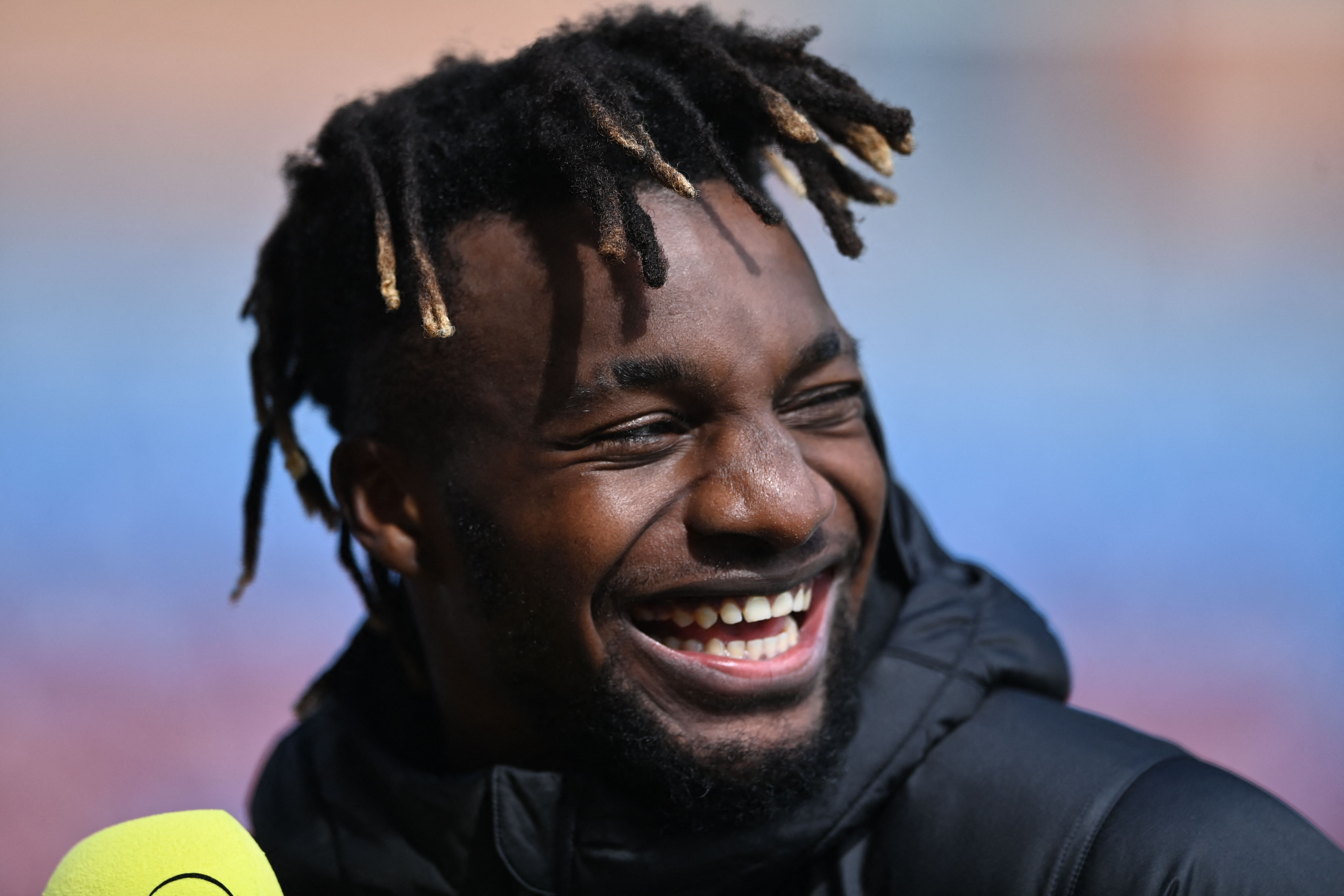 Saint-Maximin smiles whilst talking to the media after the Burnley game.