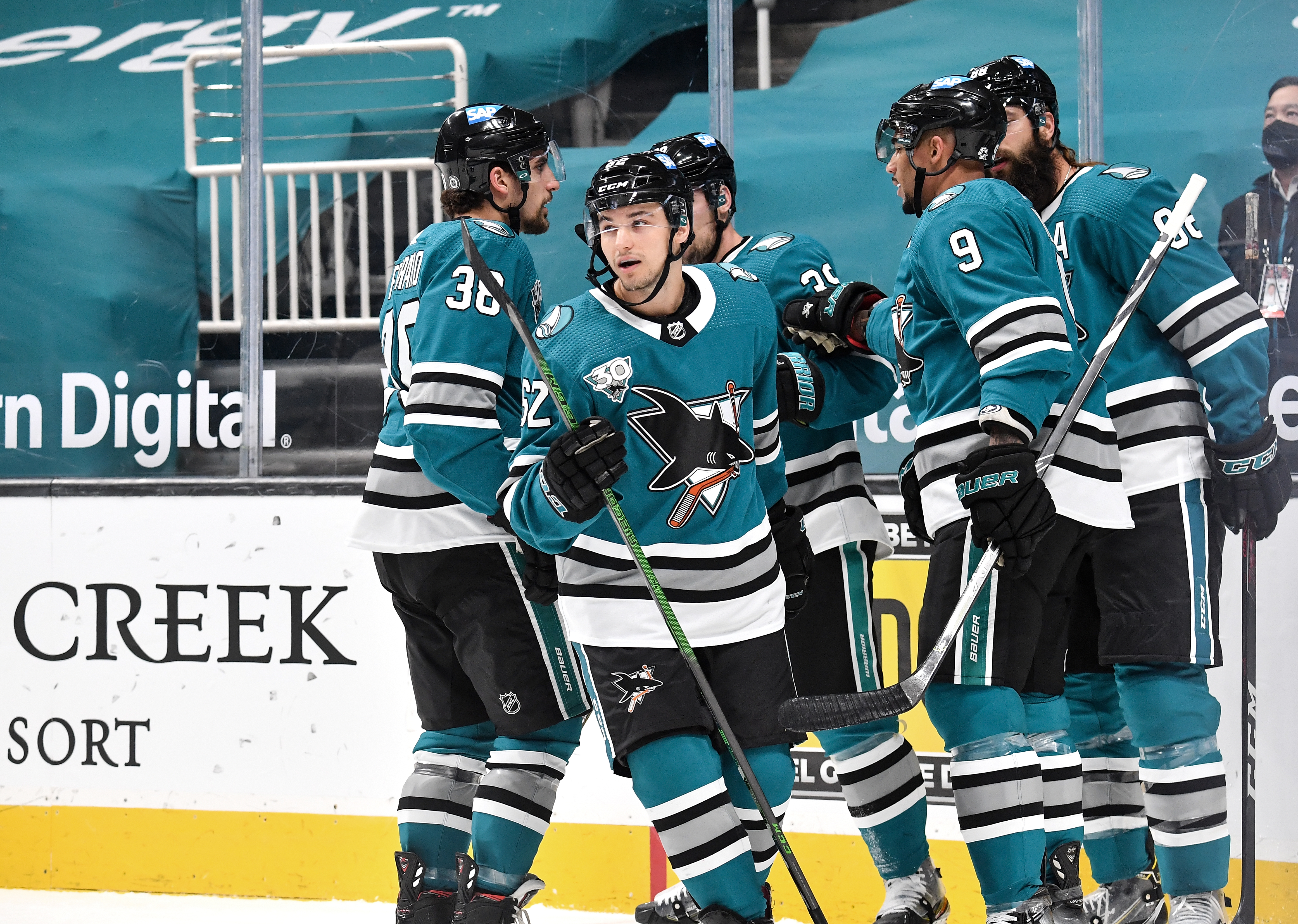 Kevin Labanc #62, Brent Burns #88, Logan Couture #39, Mario Ferraro #38 and Evander Kane #9 of the San Jose Sharks celebrate scoring a goal against the Los Angeles Kings at SAP Center on April 9, 2021 in San Jose, California.