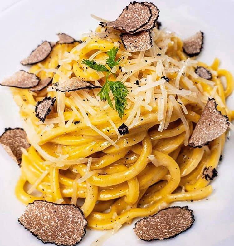 spaghetti with shaved black truffles and dusted with shredded parmesean