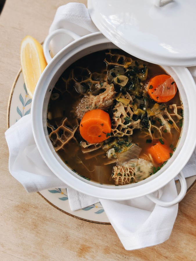 white vessel with carrots and tripe
