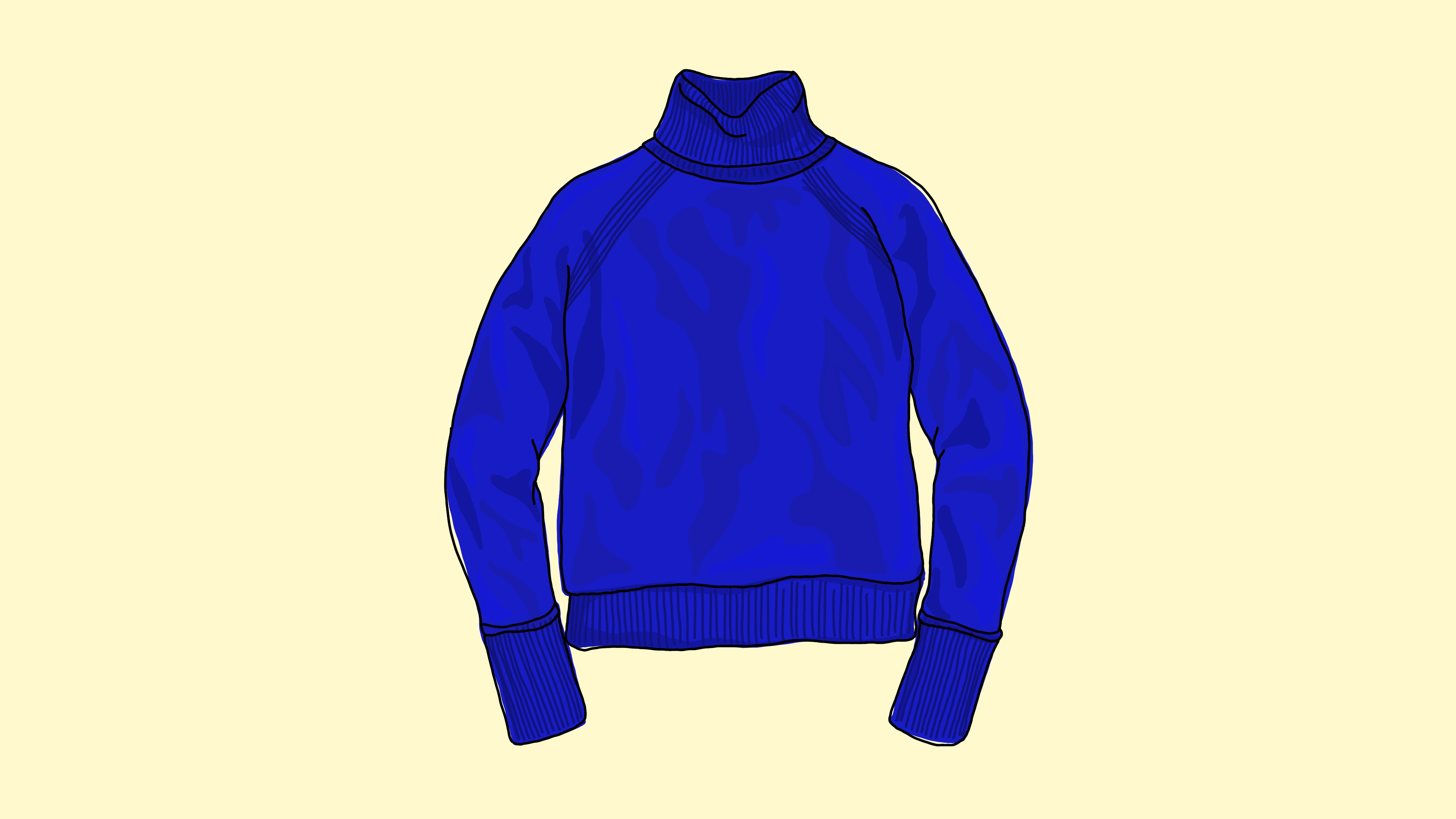 A blue sweater against a cream background.