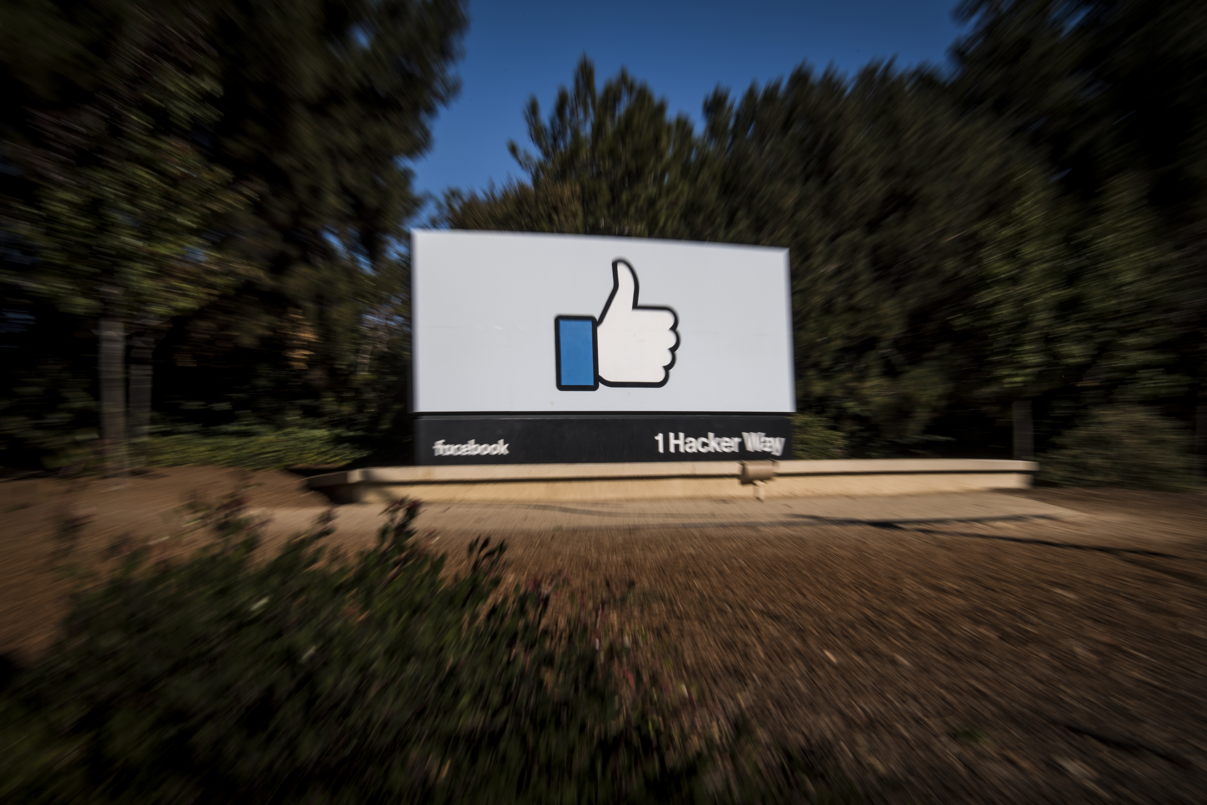 Signage is displayed outside Facebook Inc. headquarters in Menlo Park, California, U.S., on Tuesday, Oct. 30, 2018.
