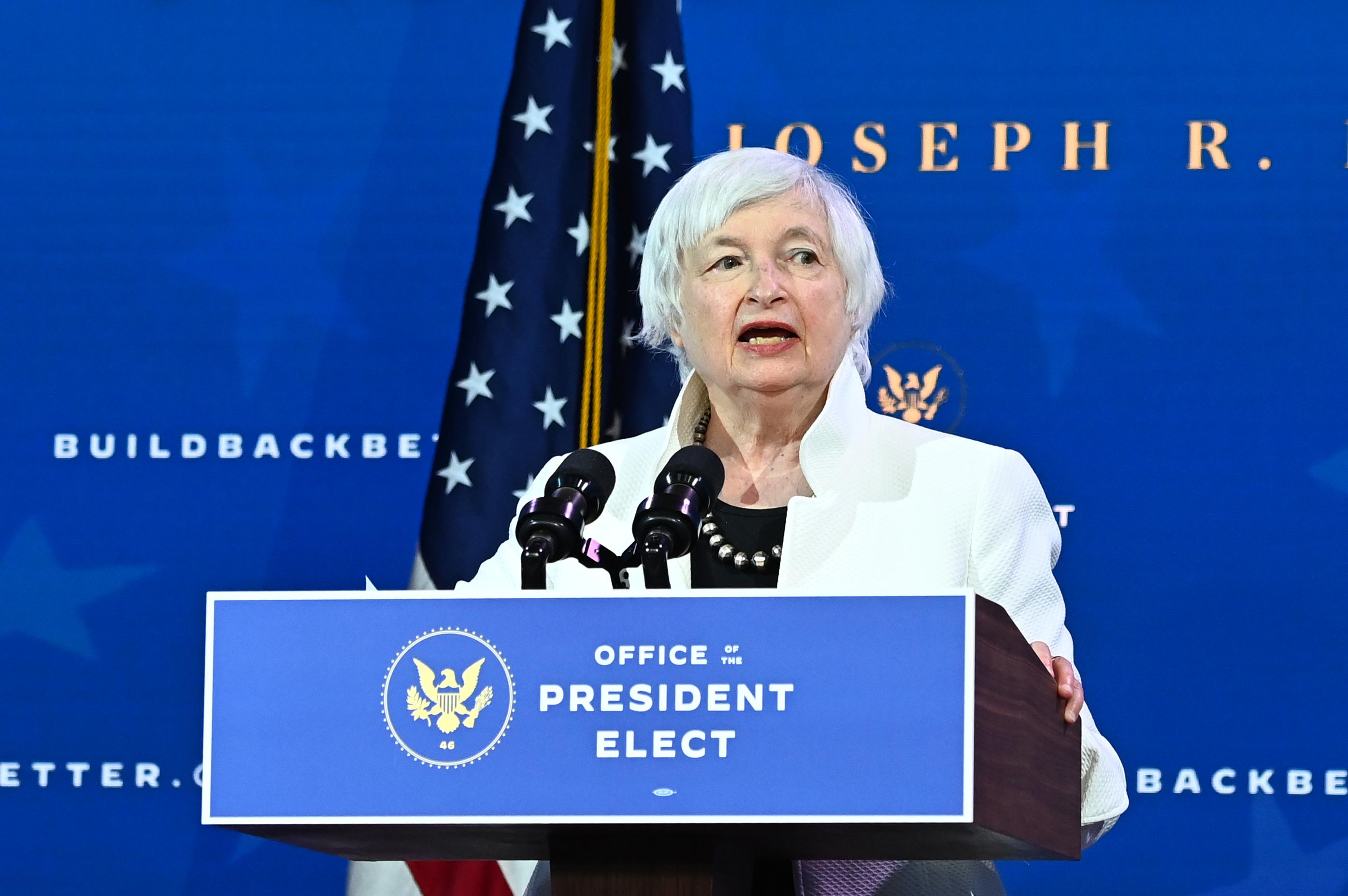 Janet Yellen speaking at a podium.