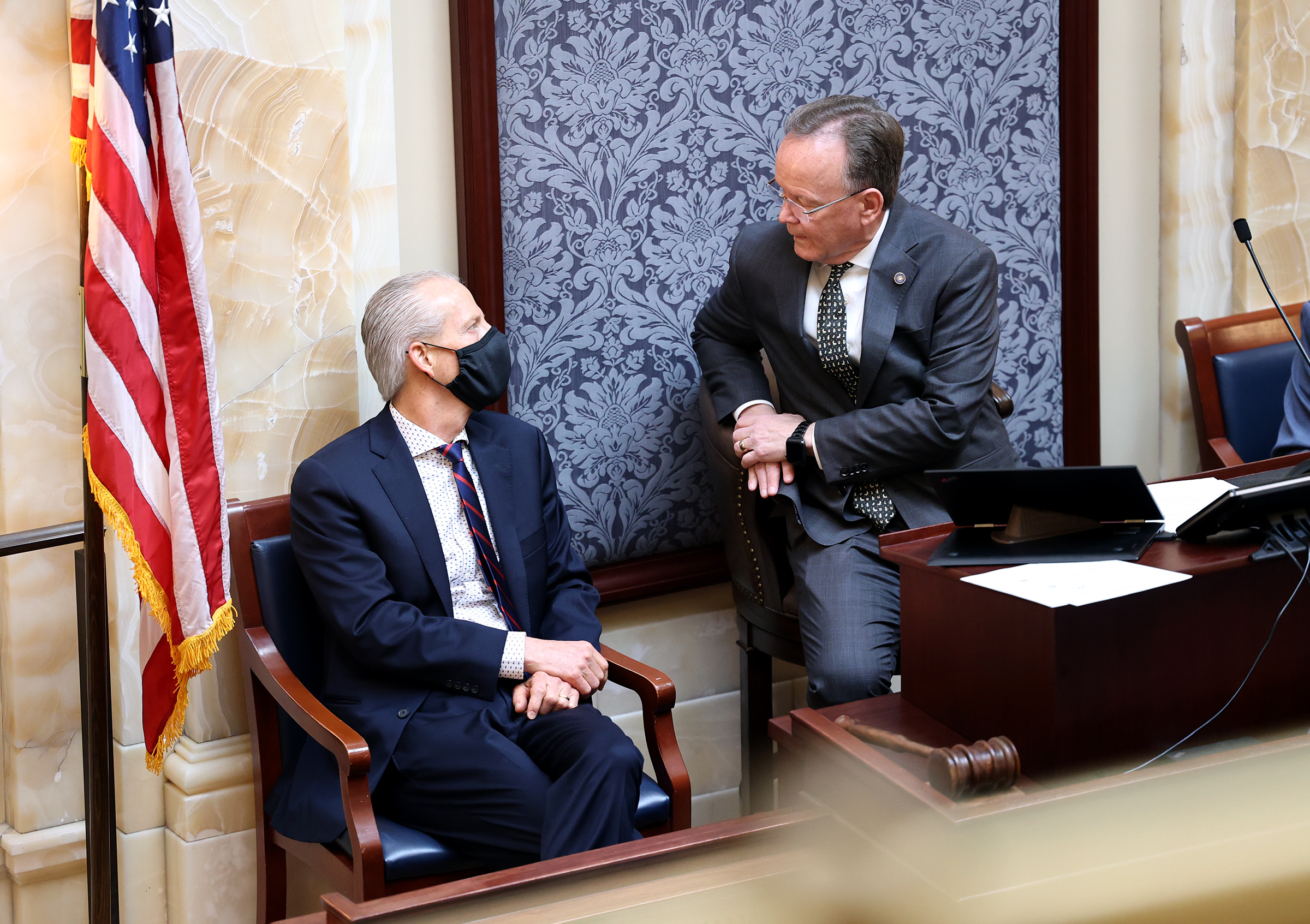 Former Senate President Wayne Niederhauser, left, talks with current Senate President Stuart Adams, R-Layton, during floor time at the Capitol in Salt Lake City on Tuesday, March 2, 2021, the last week of the 2021 session