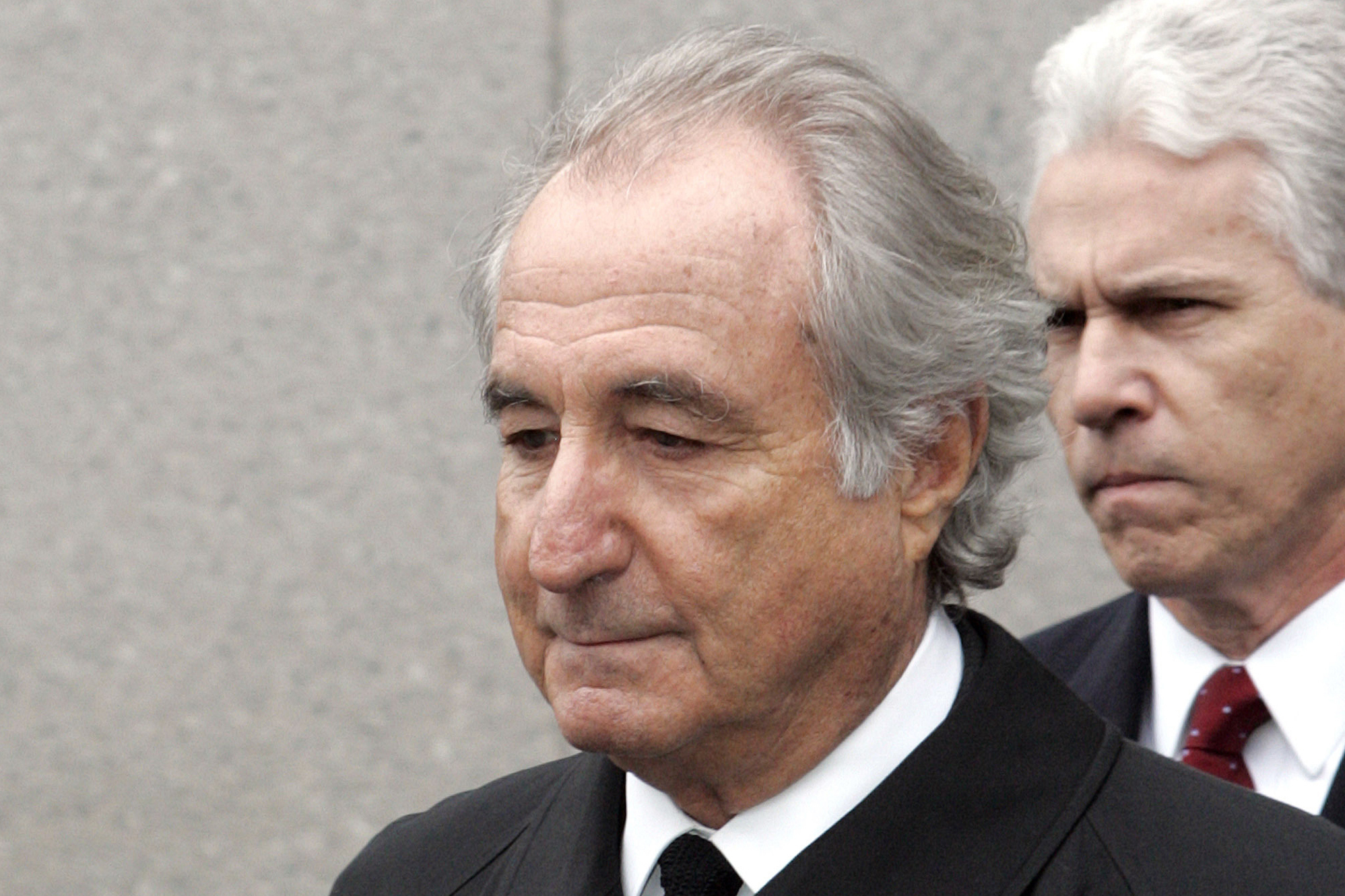 Former financier Bernie Madoff exits federal court in Manhattan, in New York, in March 2009.