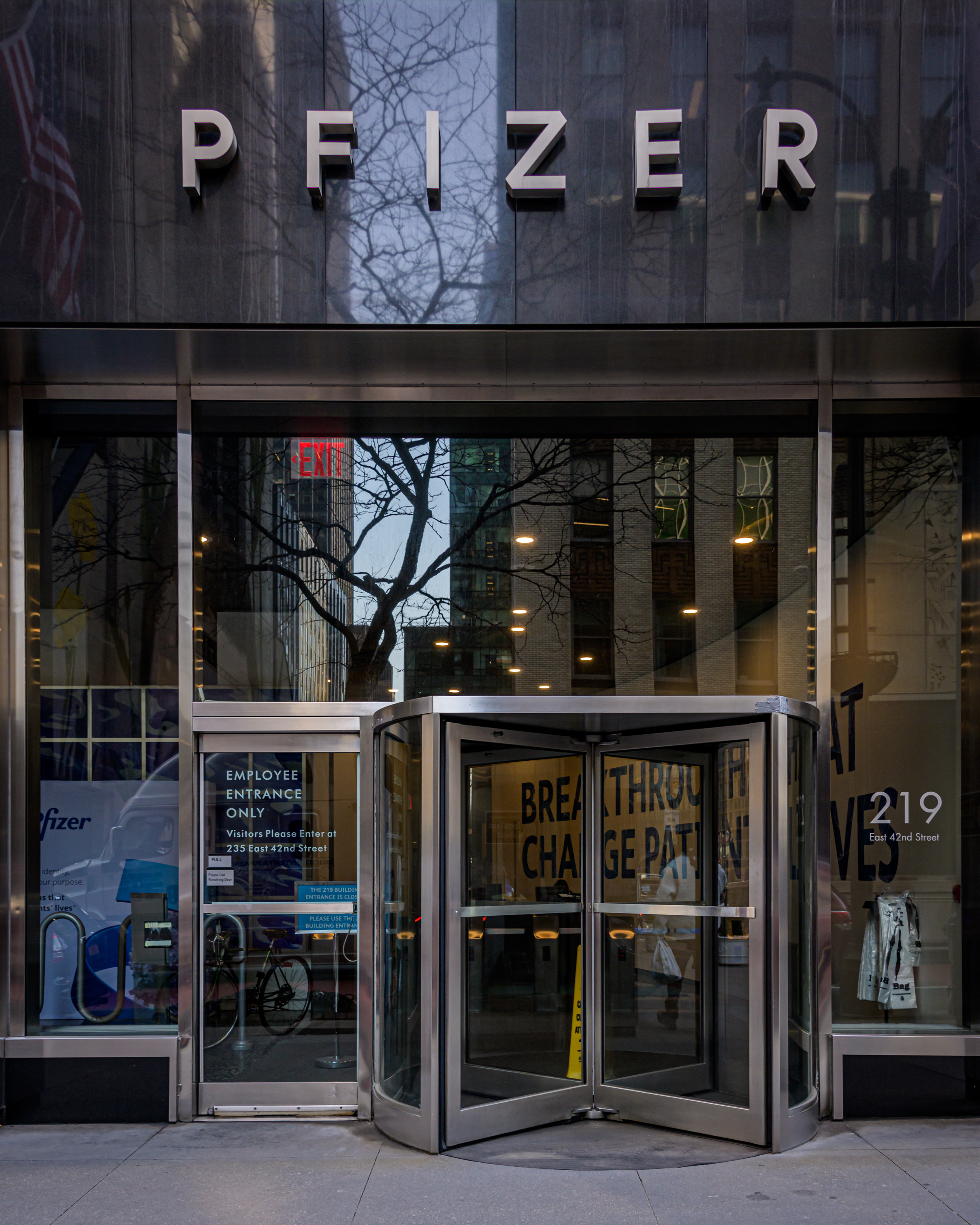 "The word ""Pfizer"" over the door of an office building."