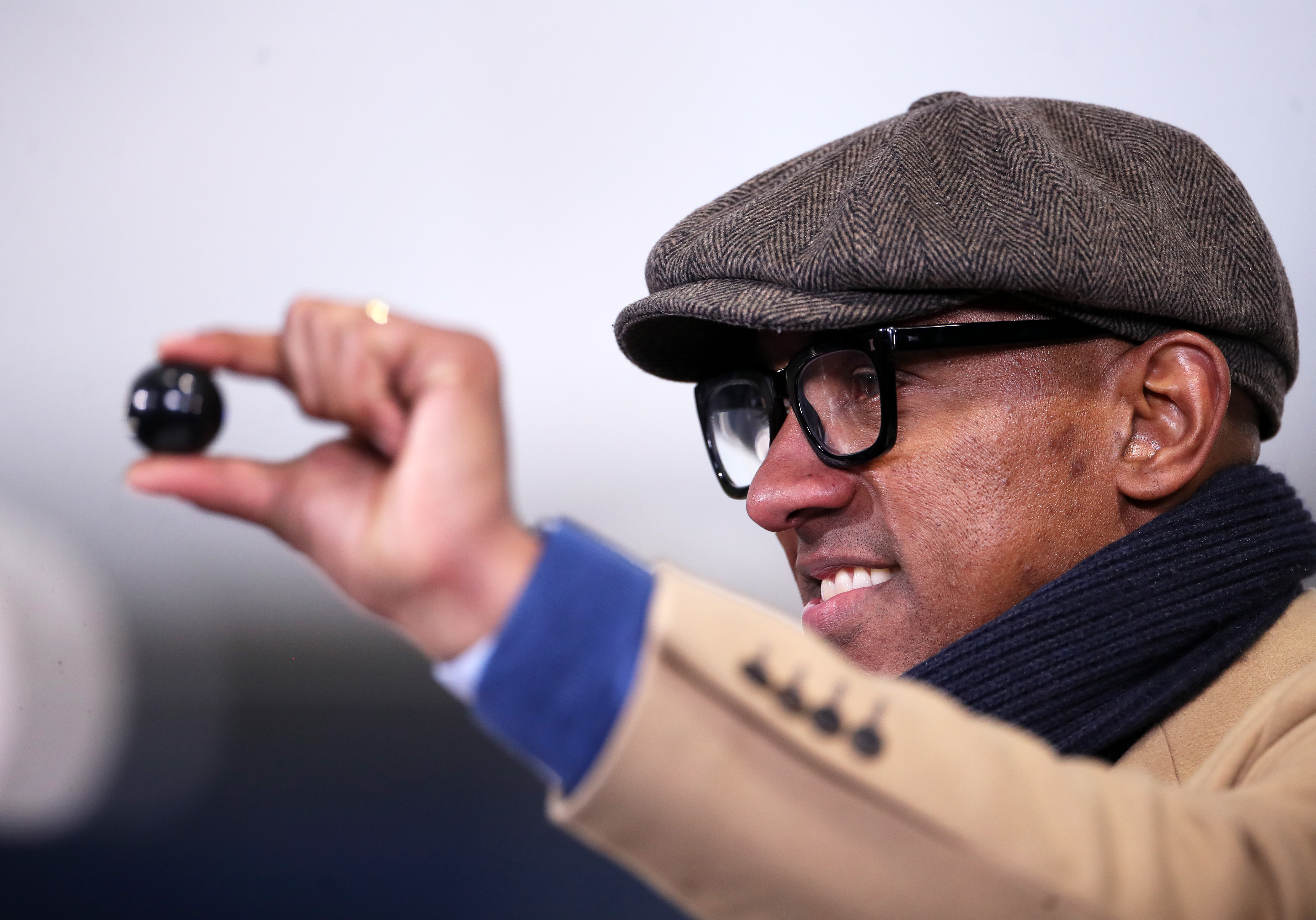 Dion Dublin, BBC Sport TV Presenter, picks out a selection-ball during the FA Cup Semifinal draw - FA Cup
