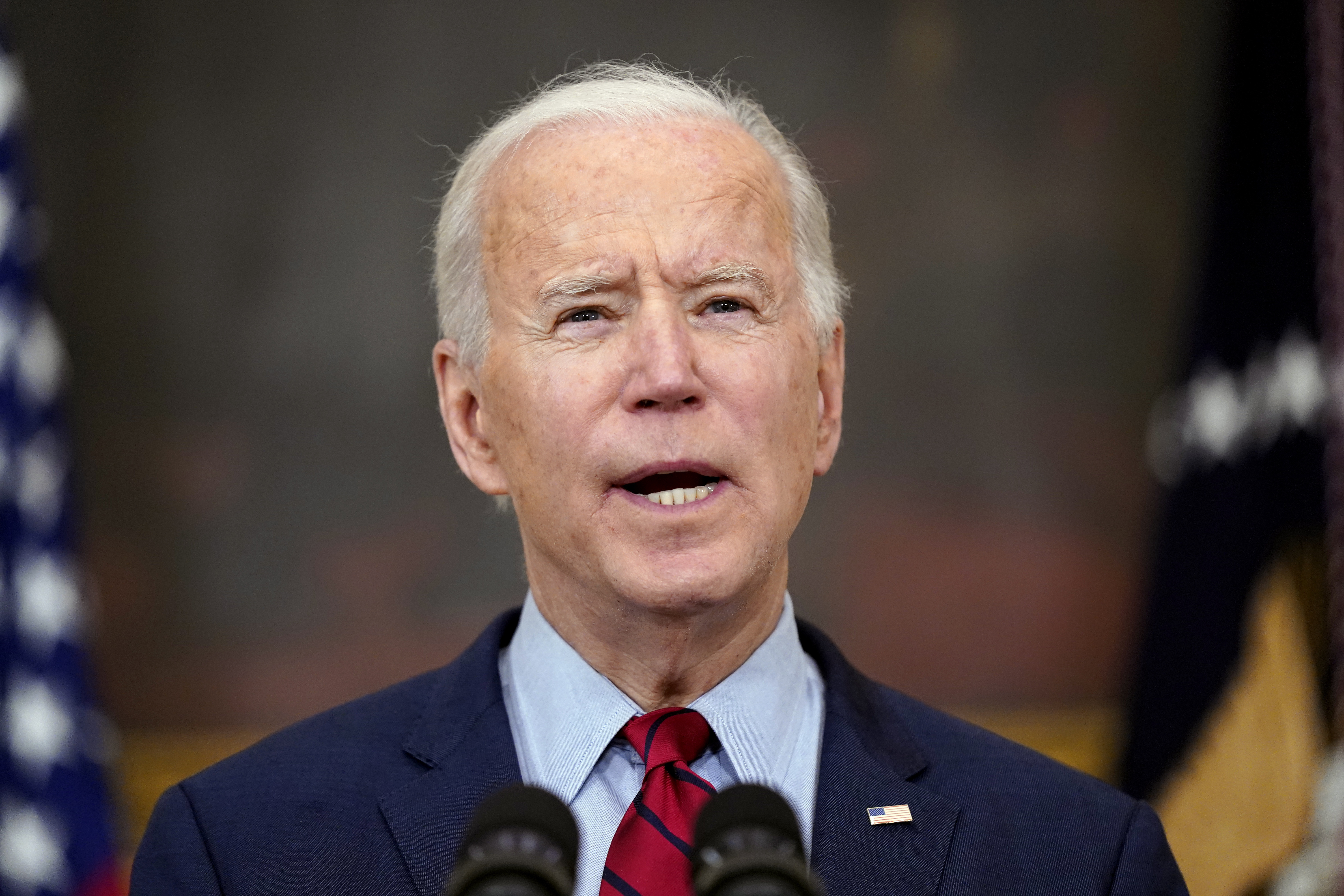 In this March 23, 2021, file photo, President Joe Biden speaks about the shooting in Boulder, Colo., in the State Dining Room of the White House in Washington.