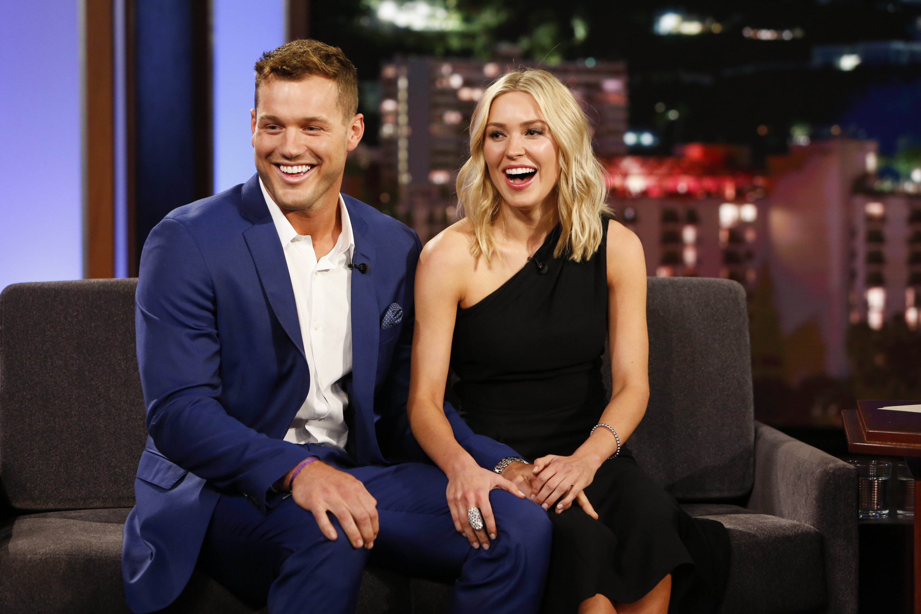 Colton Underwood and Cassie Randolph sitting together on a television stage.