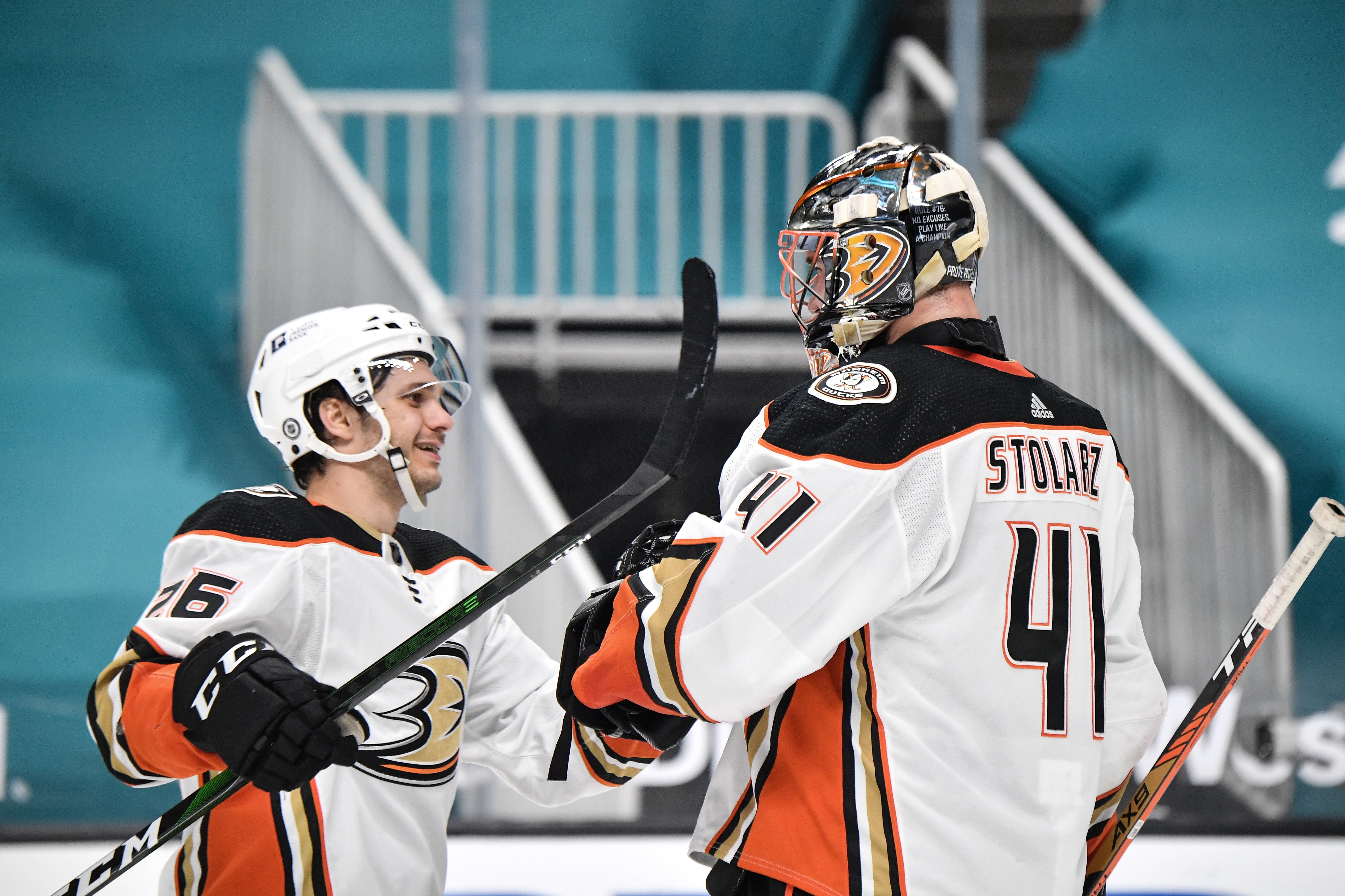 Anthony Stolarz #41 and Andrew Agozzino #26 of the Anaheim Ducks celebrate the win against the San Jose Sharks at SAP Center on April 12, 2021 in San Jose, California.
