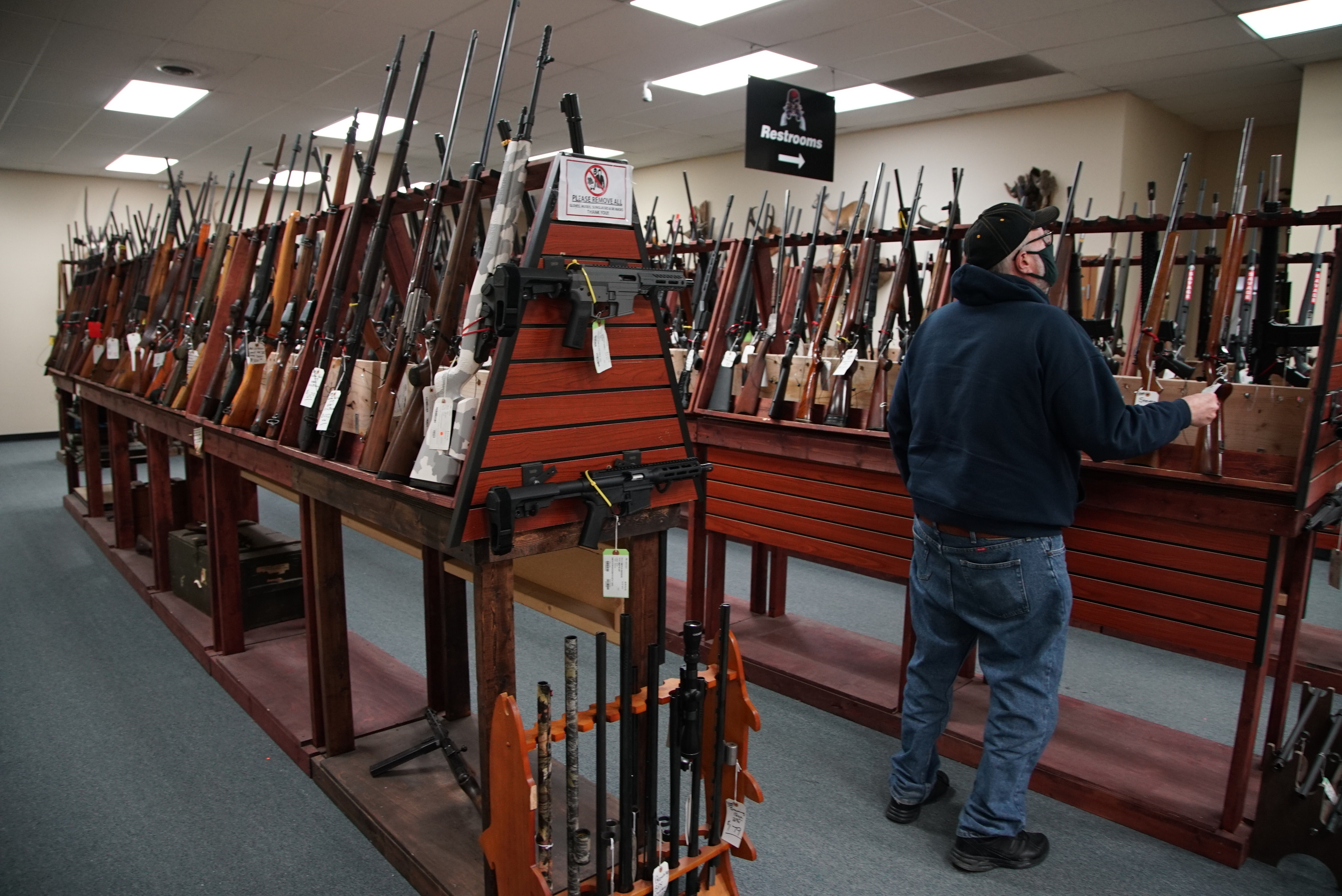 A customer browses firearms at Marengo Guns in Marengo in January.