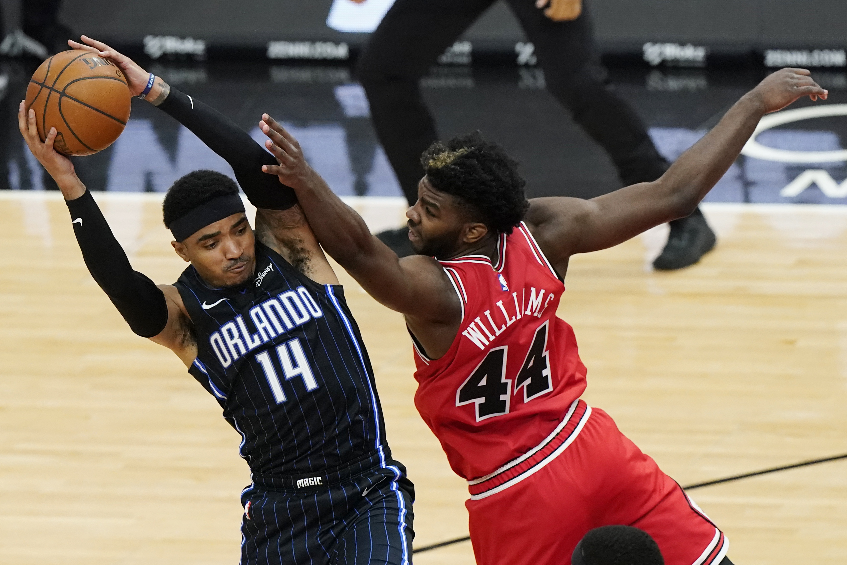 Magic guard Gary Harris pulls in a rebound next to Bulls forward Patrick Williams during the second half Wednesday night.