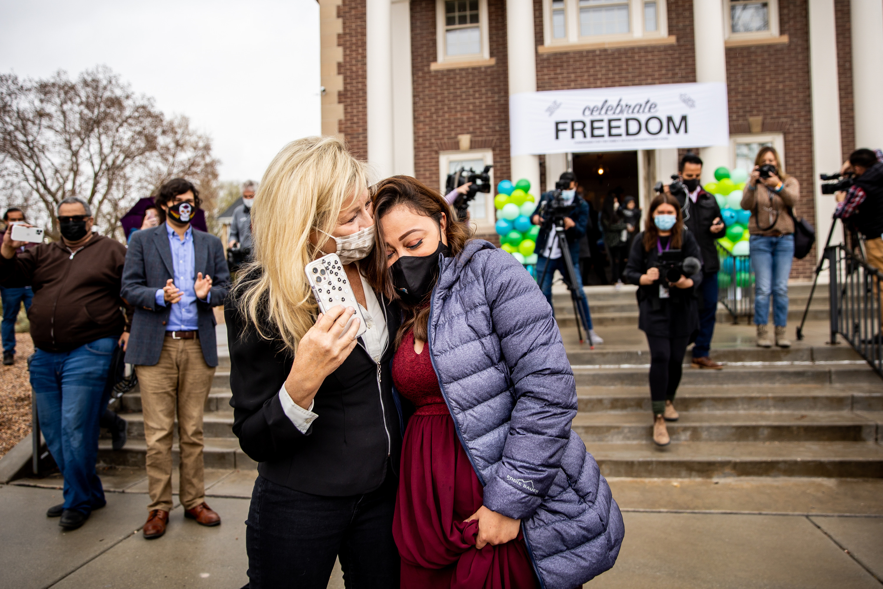 Vicky Chavez, right, embraces Lisa Hyte, a member of the sanctuary committee at the First Unitarian Church of Salt Lake City, as Chavez leaves the church on Thursday, April 15, 2021. Chavez has received a one-year stay of removal after spending more than three years living in sanctuary inside the church.