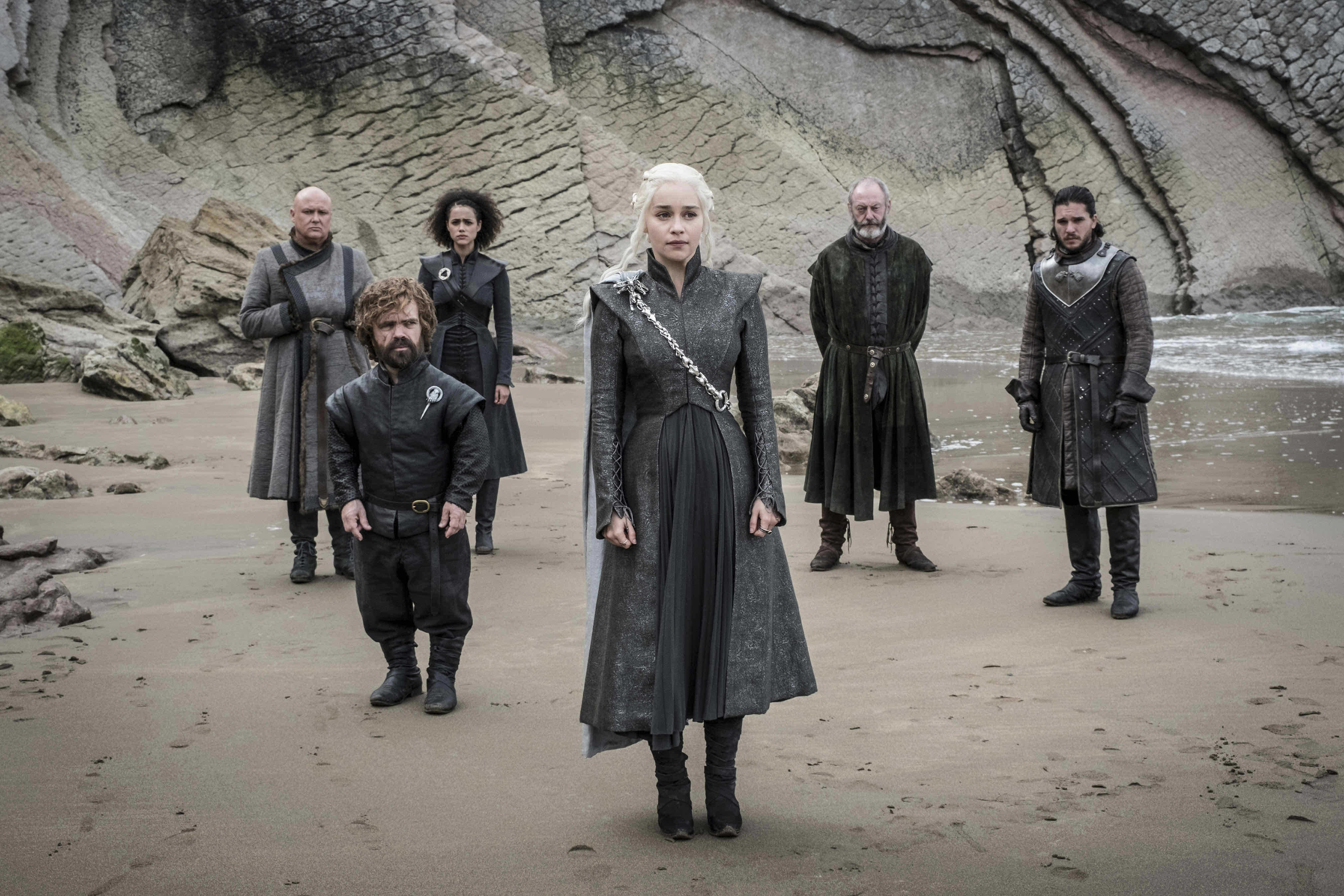 Game of Thrones characters standing on a beach.