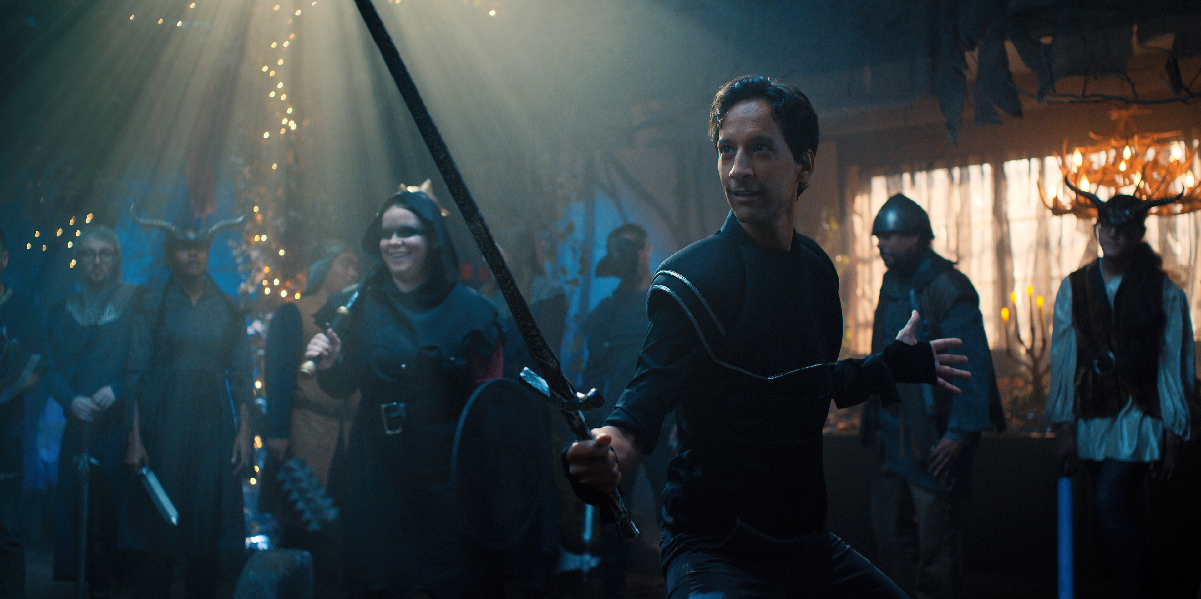 Brad Bakshi, played by Danny Pudi, strikes a pose in a swordsman costume.
