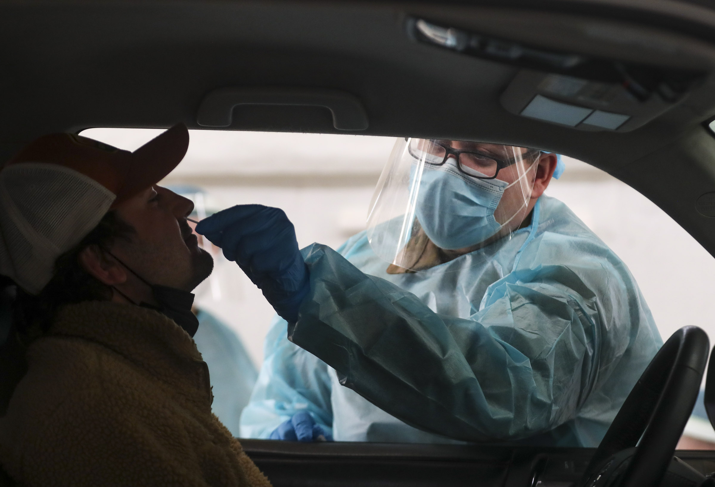 Utah National Guard soldier Ebbin Wyatt administers a COVID-19 test to Nick Bradley at the Utah State Fairpark in Salt Lake City on Monday, March 8, 2021.