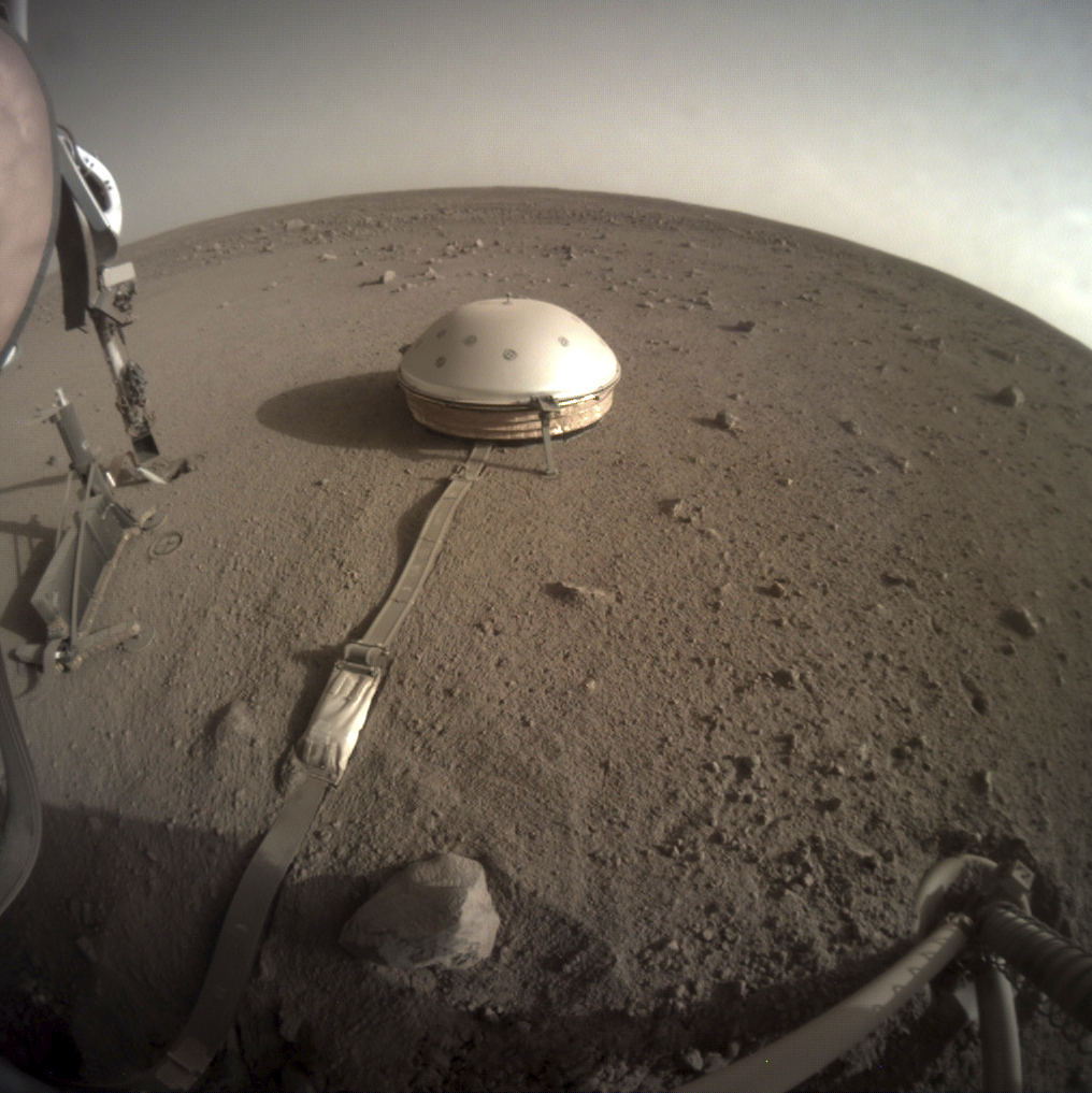 This Feb. 18, 2020 photo made available by NASA shows the InSight lander's dome-covered seismometer, known as SEIS, on Mars. On Monday, Feb. 24, 2020, scientists reported that the spacecraft has detected hundreds of quakes and even aftershocks that are regularly jolting the red planet.