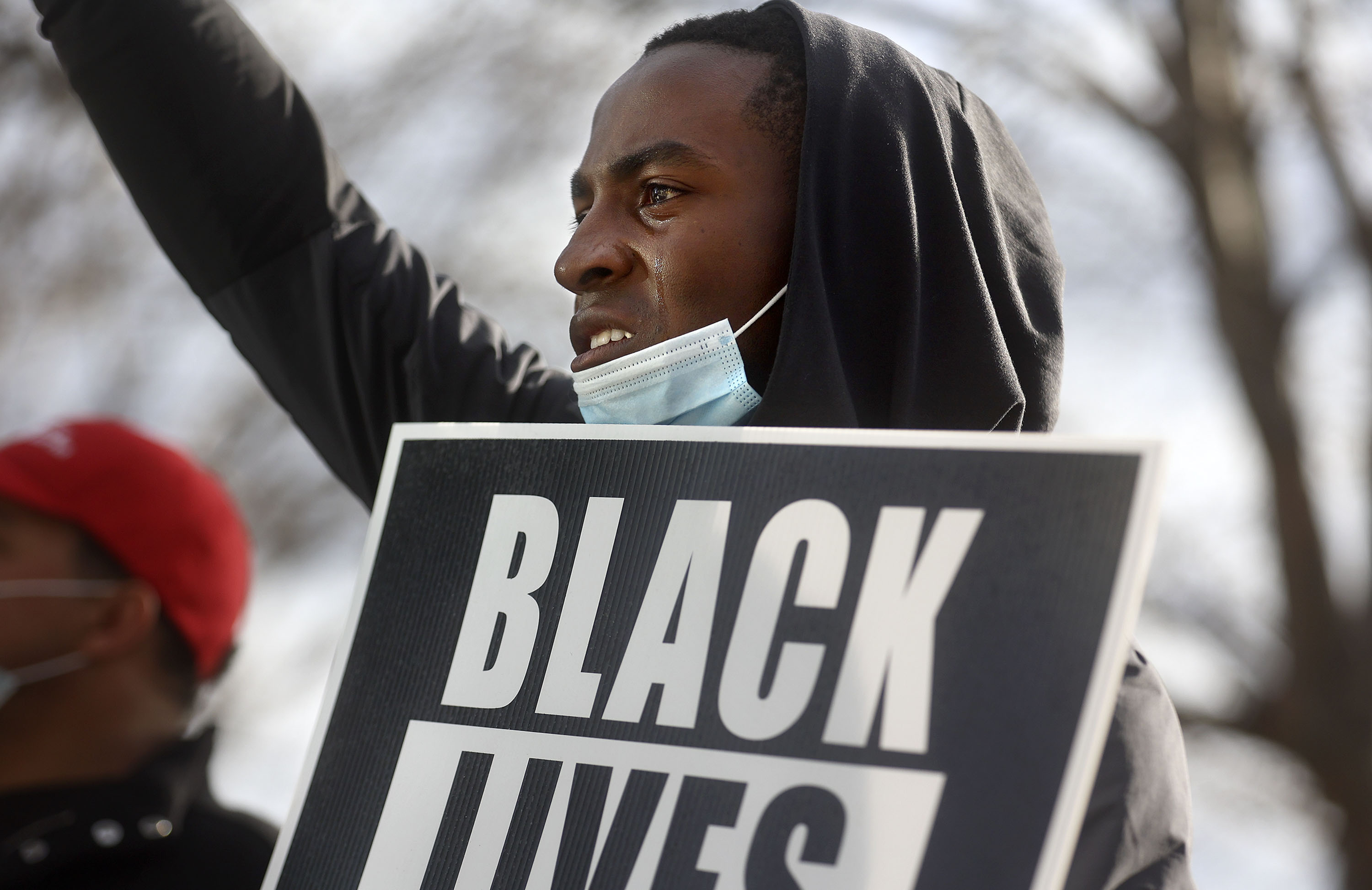 Tears run down Ben Chamberlain's cheeks as he listens to a speaker during a Black Lives Matter protest in front of the Salt Lake City Public Safety Building in Salt Lake City on Friday, April 16, 2021.