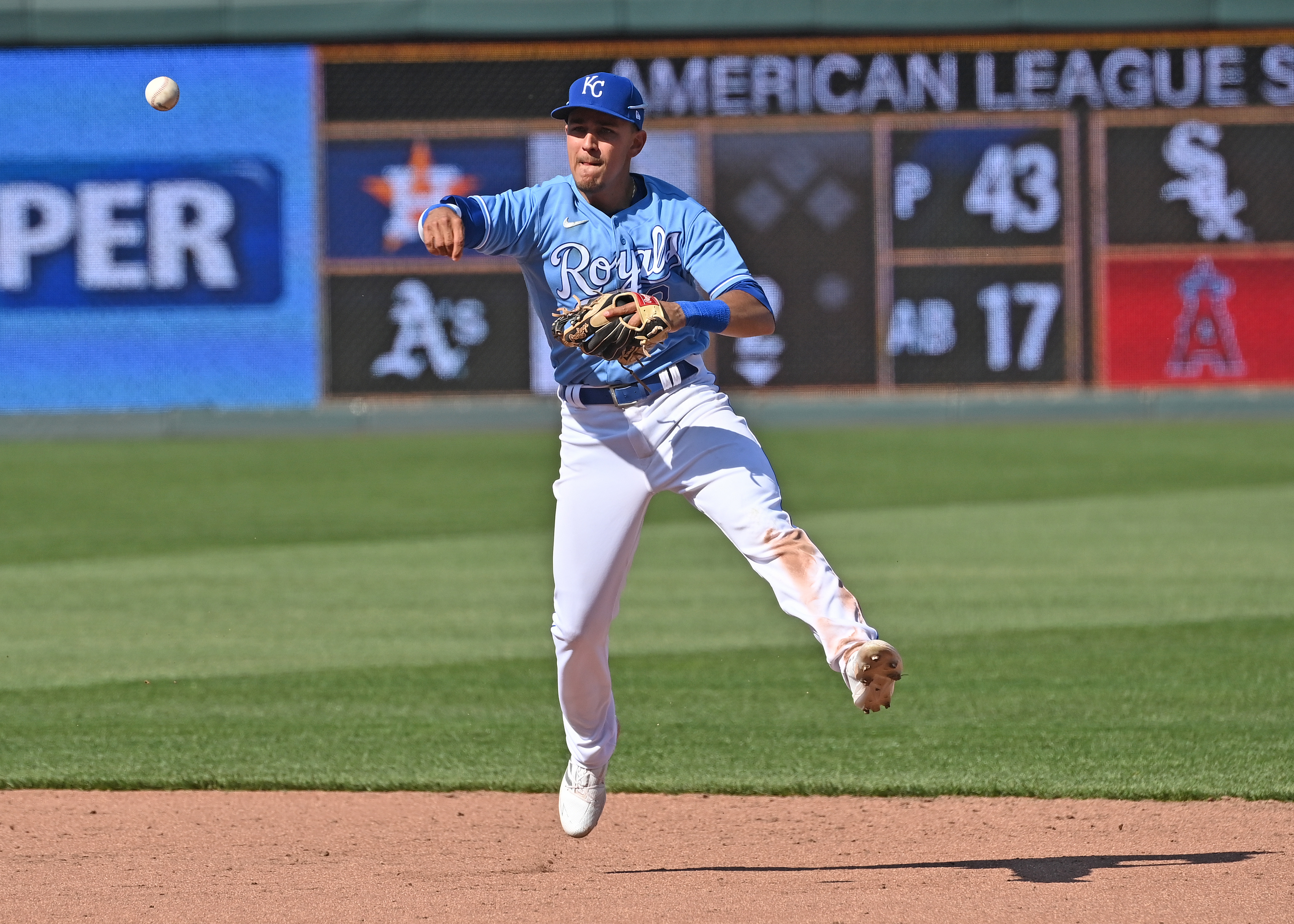 Nicky Lopez makes a throw to firstbase