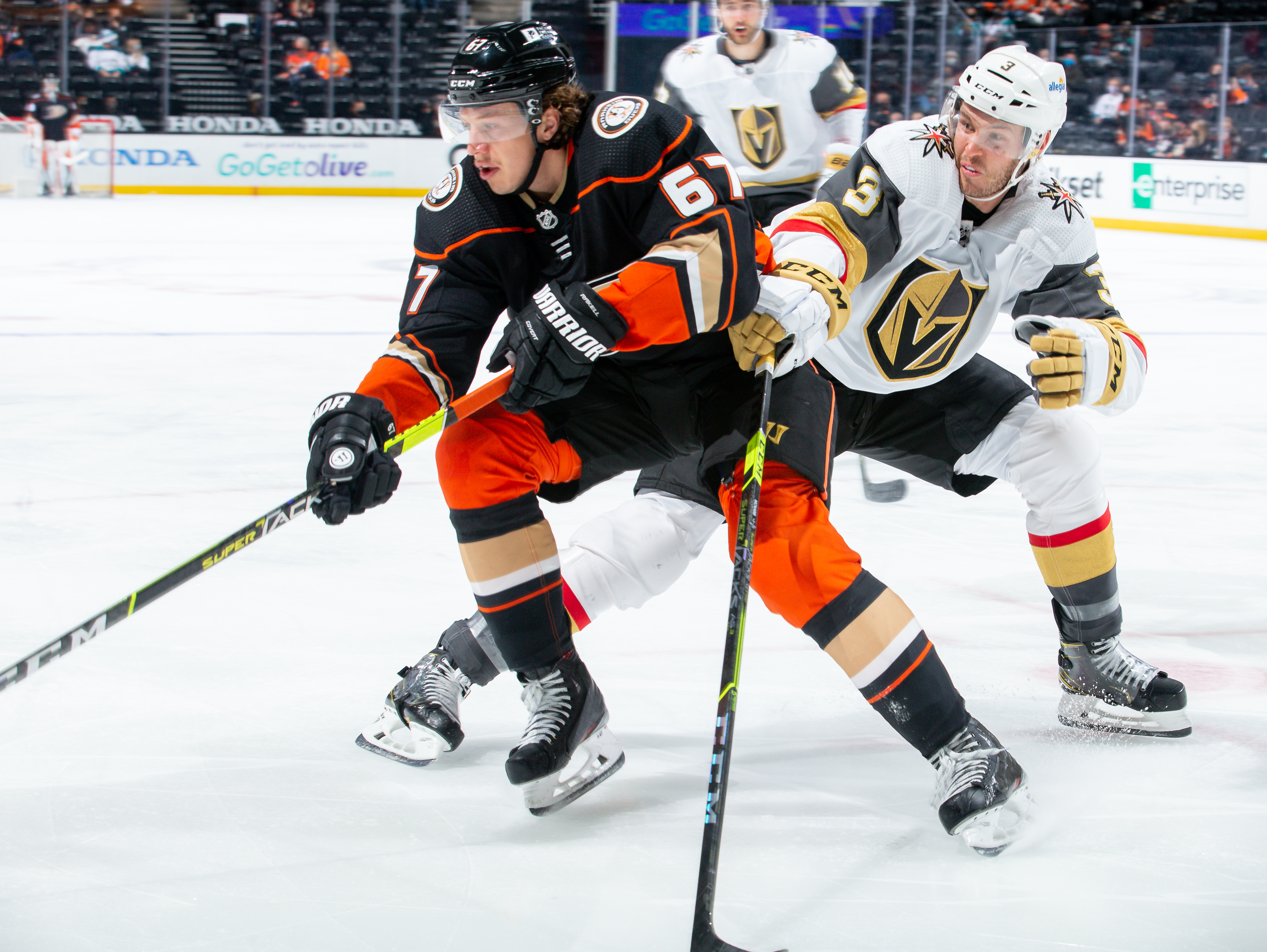 Rickard Rakell #67 of the Anaheim Ducks and Brayden McNabb #3 of the Vegas Golden Knights battle for the puck during the second period of the game at Honda Center on April 16, 2021 in Anaheim, California.
