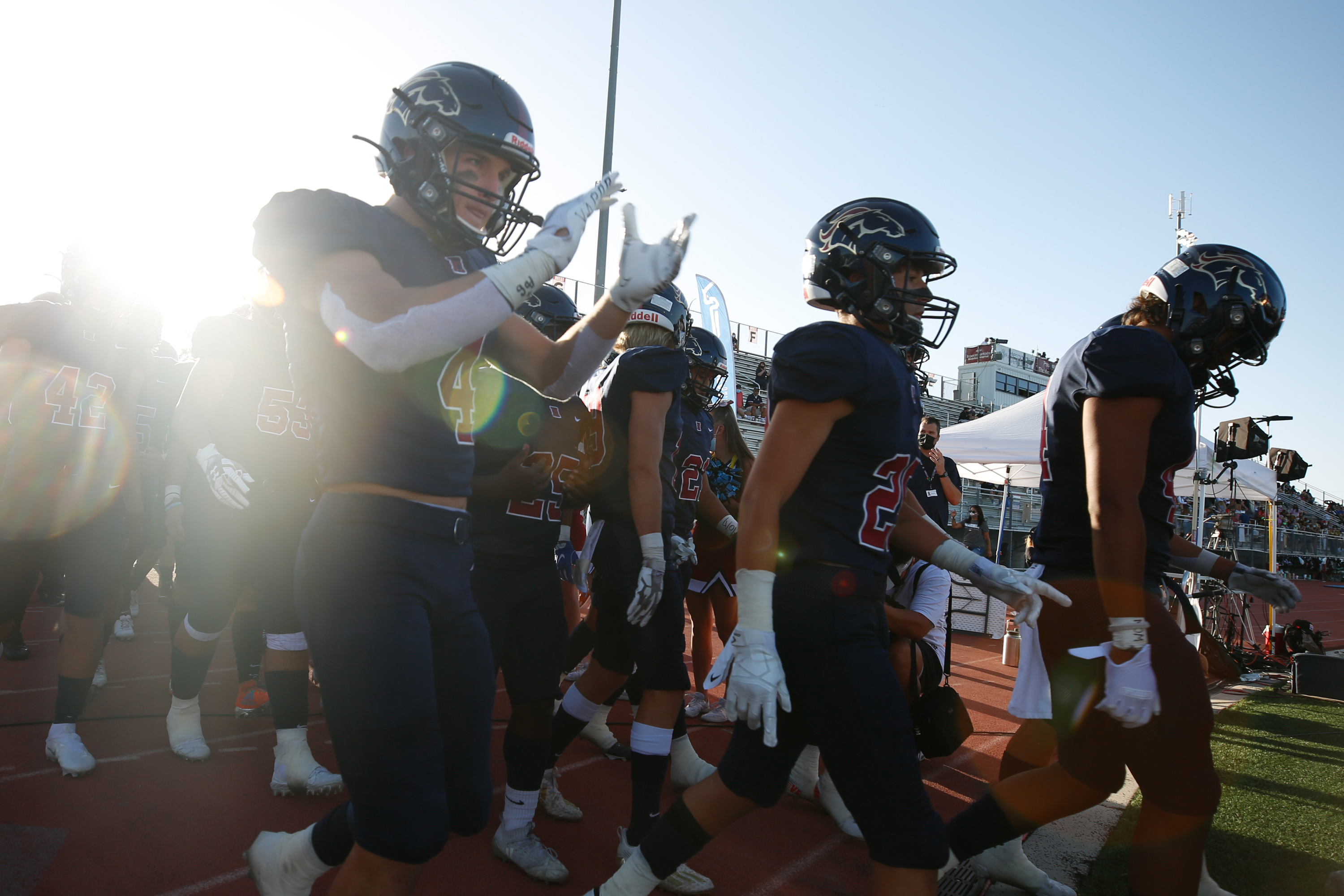 Herriman players walk onto the field of Mustang Stadium before a high school football game against Davis at Herriman High School in Herriman on Thursday, Aug. 13, 2020.