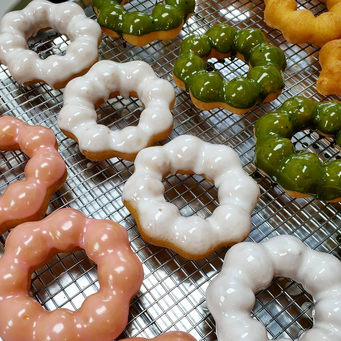 Pink, white, and green doughnuts from Mochinut