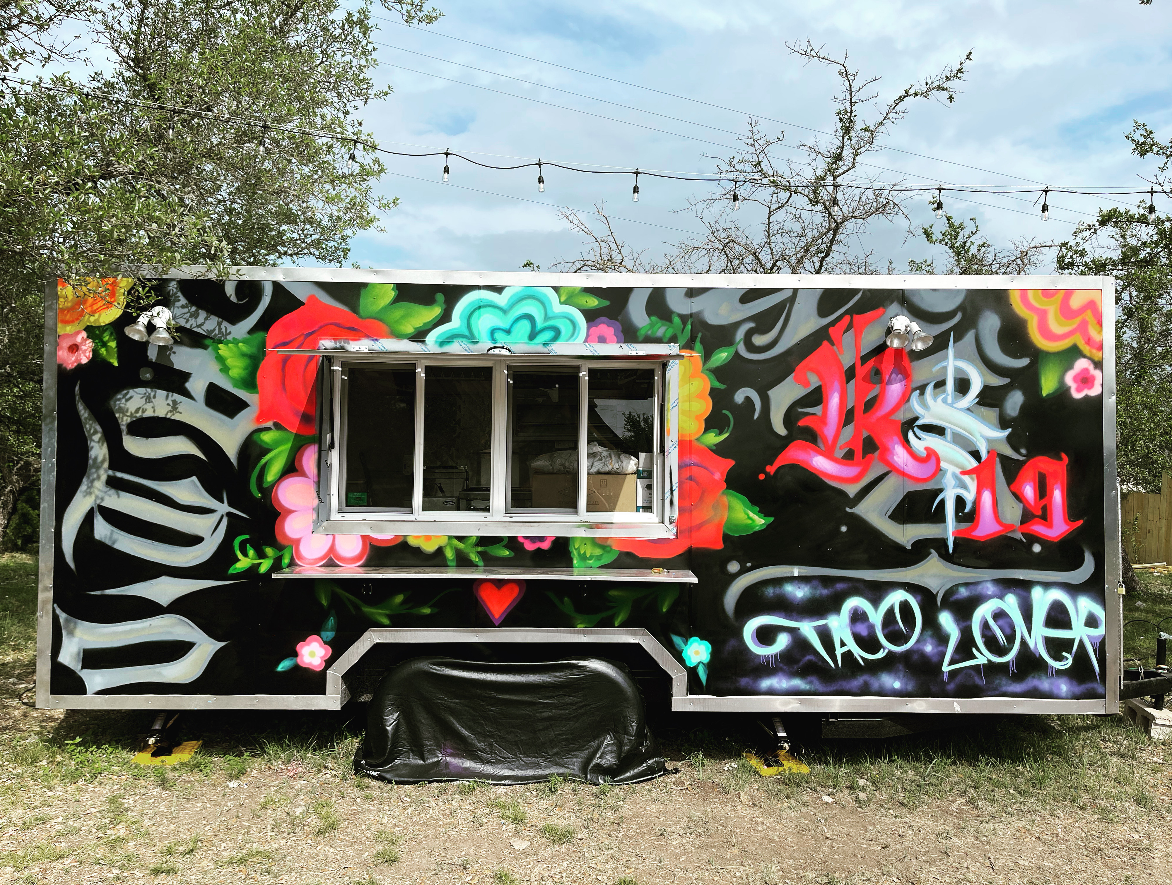 Food truck decorated with taco graffiti
