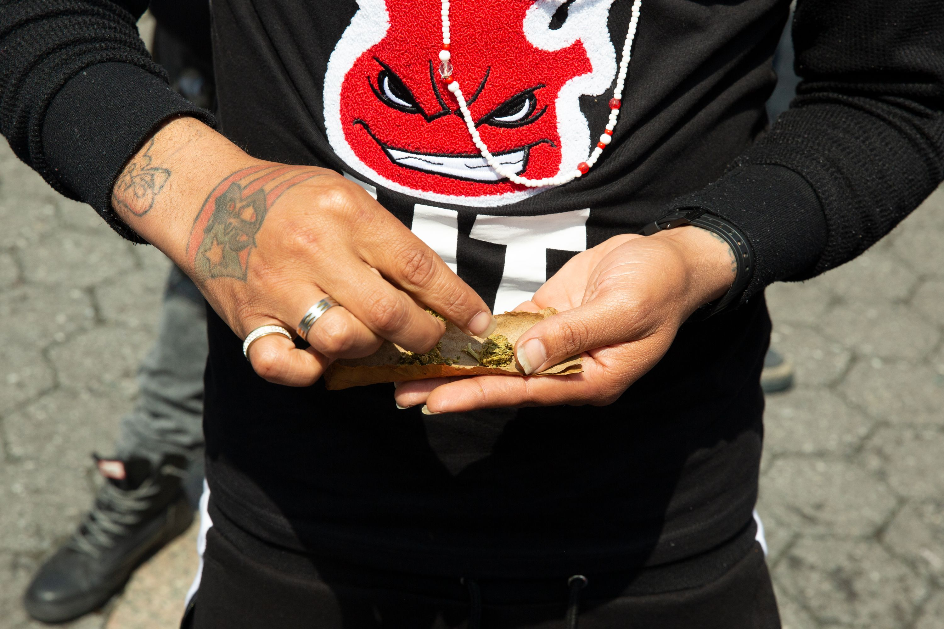 A smoker rolls a joint in Union Square during a rally advocating the legalization of recreational marijuana use, May 4, 2019.