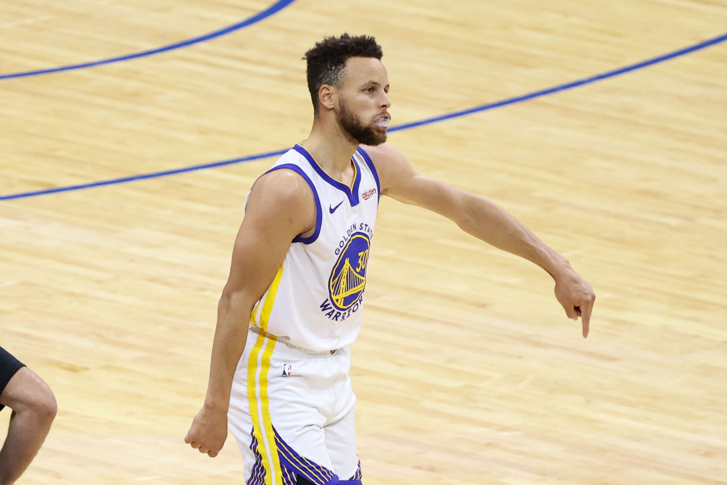 Golden State Warriors guard Stephen Curry reacts after his score against the Philadelphia 76ers during the second quarter at Wells Fargo Center.